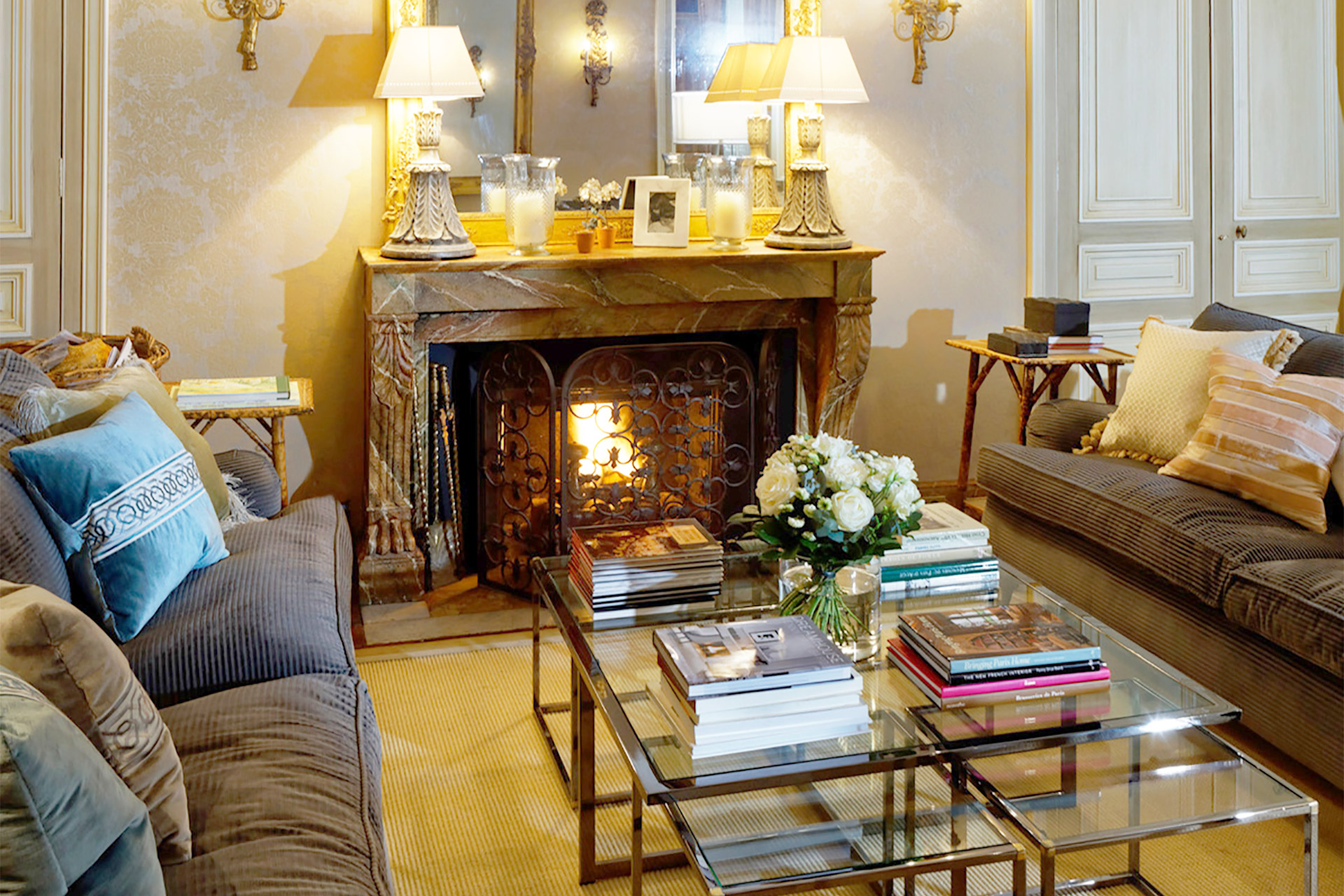 Relax in this elegant living room centered around the original marble fireplace in the Bailly Paris vacation rental