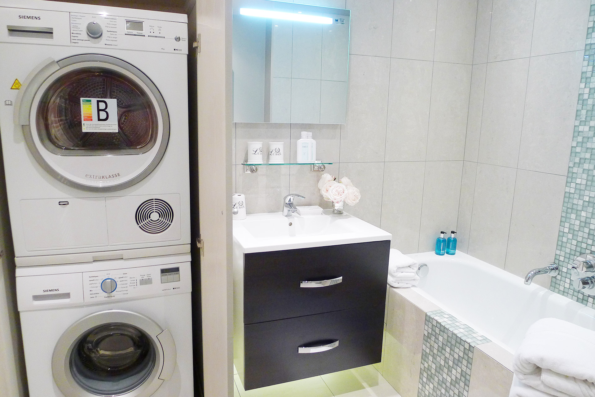 Separate washing machine and dryer in the Beaujolais master bathroom with Paris Perfect
