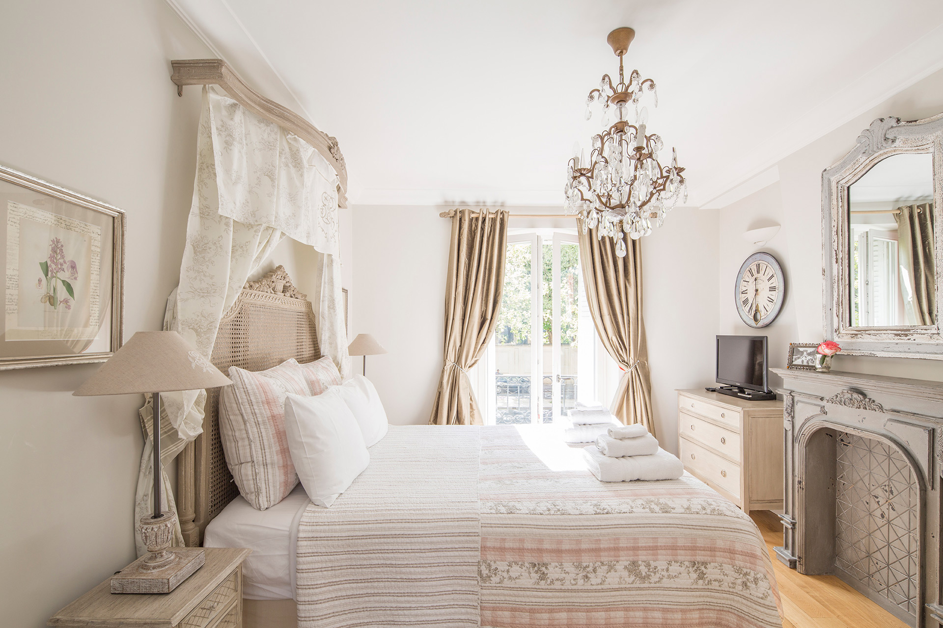 Romantic bedroom 1 with queen size bed in the Beaujolais vacation rental offered by Paris Perfect
