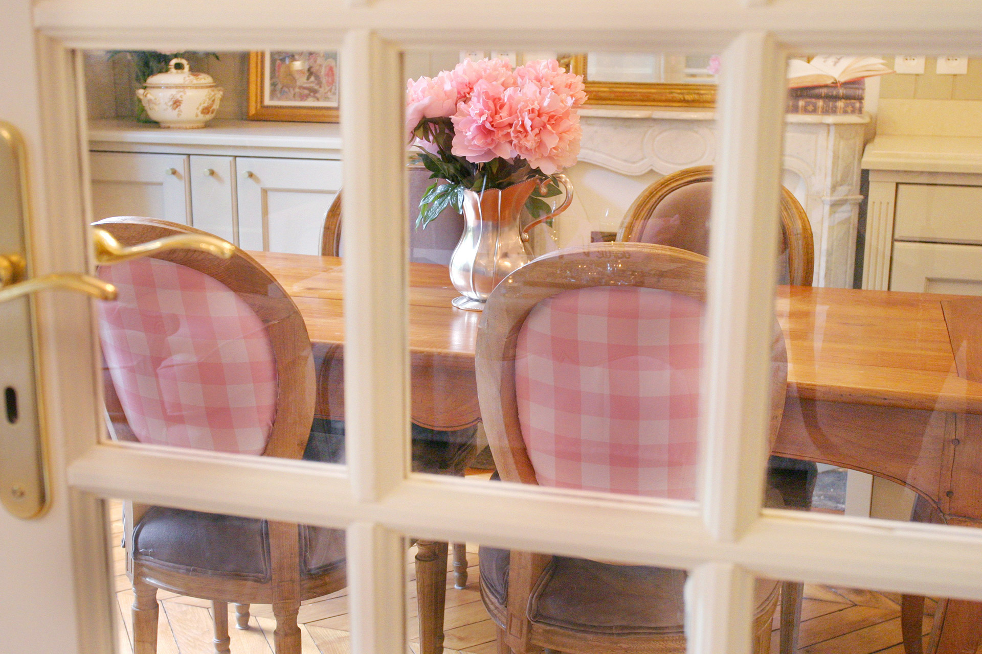 Peek through the French doors in the living room to the dining table