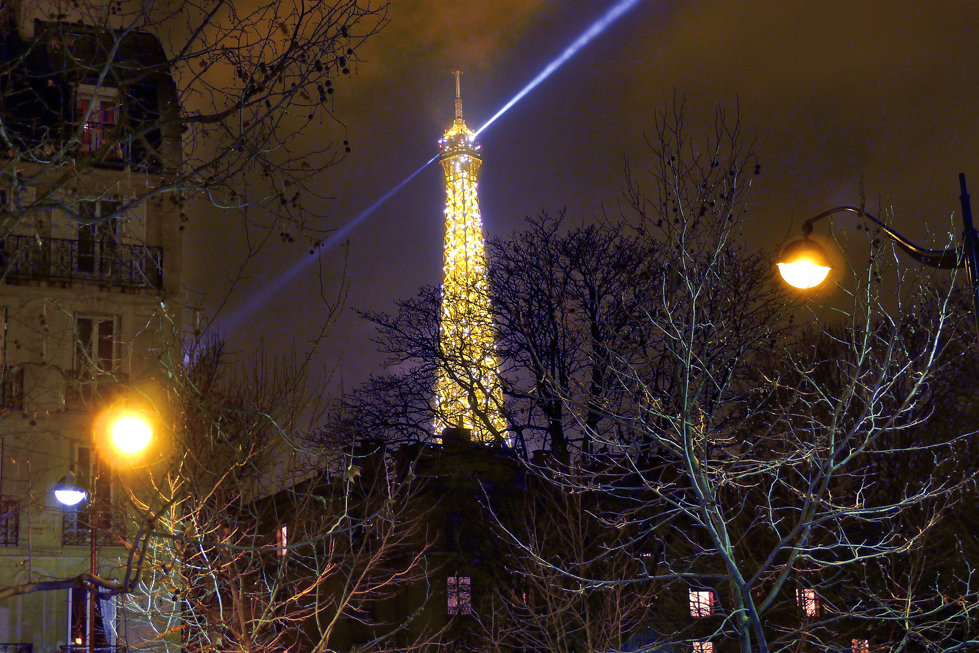 Watch the Eiffel Tower light up at night from the Beaune Paris apartment