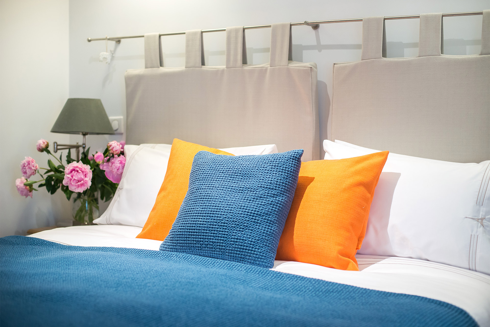 High quality linens on the bed of the Bel-Air vacation rental offered by Paris Perfect