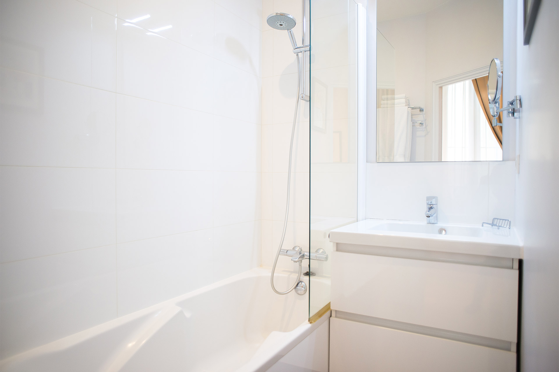 Master bathroom with bathtub and sink in the Bel-Air vacation rental offered by Paris Perfect