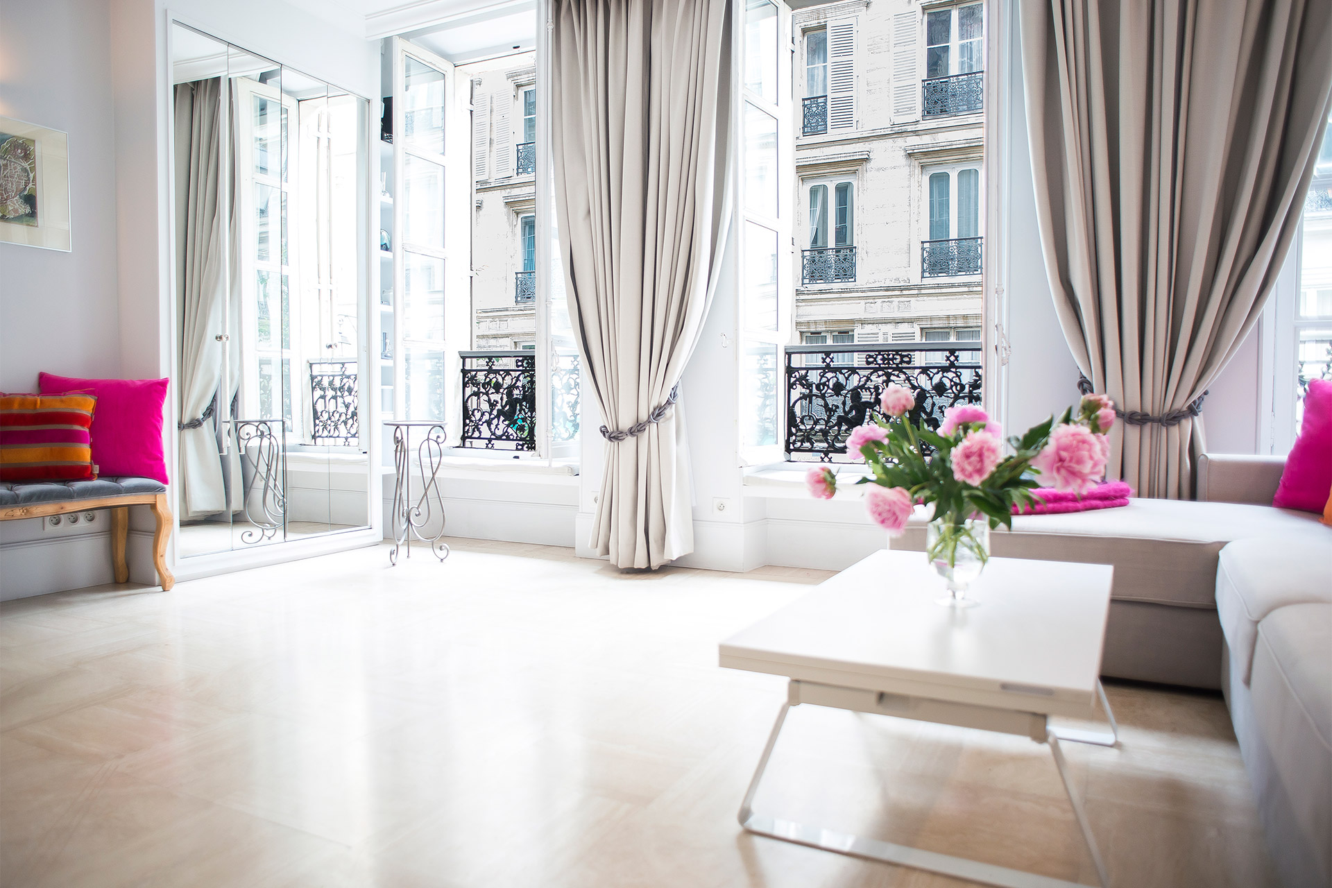 Large windows in the Living Room of the Bel-Air vacation rental offered by Paris Perfect