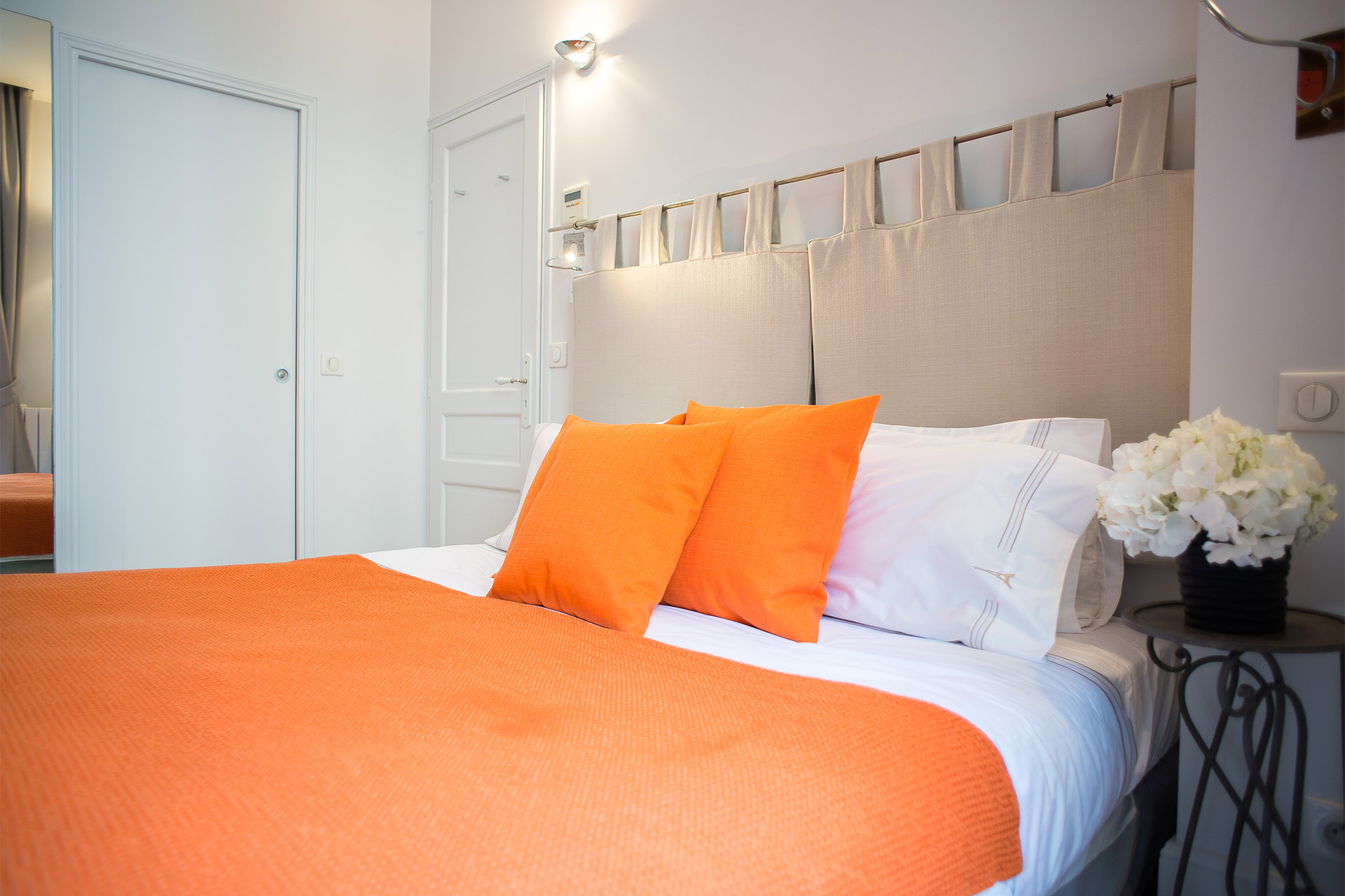 Luxurious bedding in the Bel-Air vacation rental offered by Paris Perfect