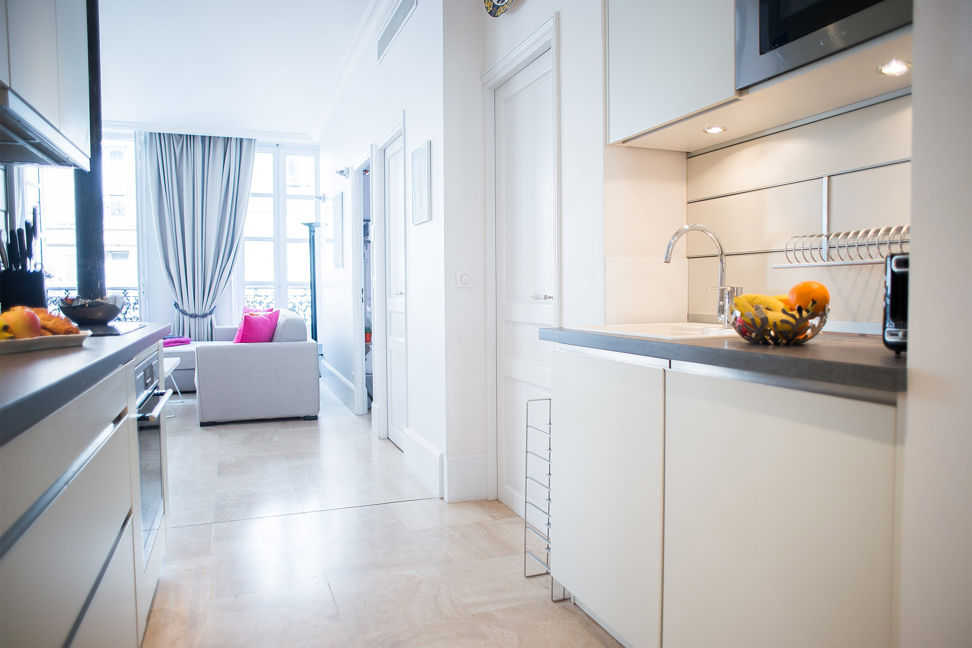 Sliding door to the kitchen in the Bel-Air vacation rental offered by Paris Perfect