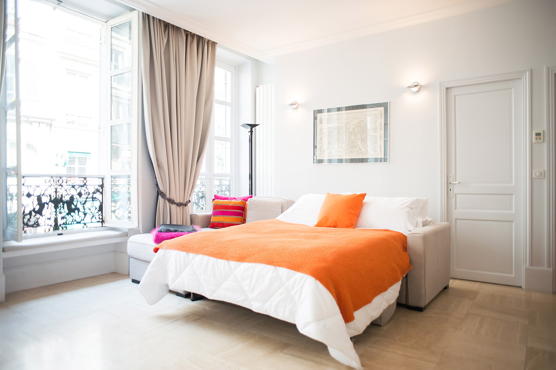 Sofa converts into a comfortable double bed in the Bel-Air vacation rental offered by Paris Perfect