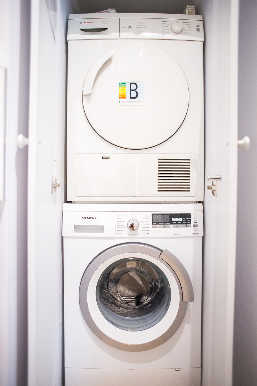 Separate washing machine and dryer in the Bel-Air vacation rental offered by Paris Perfect