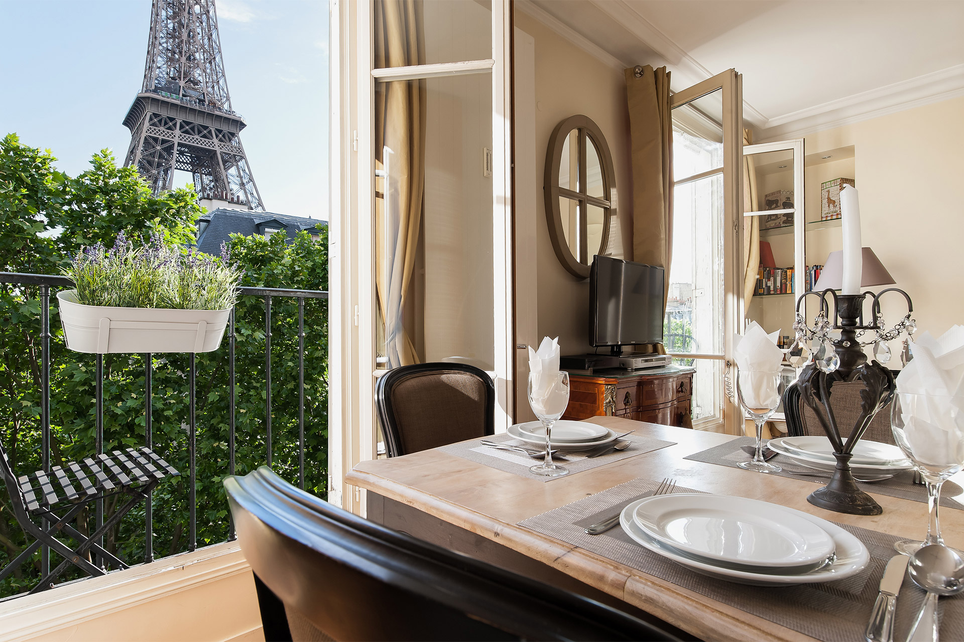 Eiffel Tower view from the dining table in the Bergerac vacation rental offered by Paris Perfect
