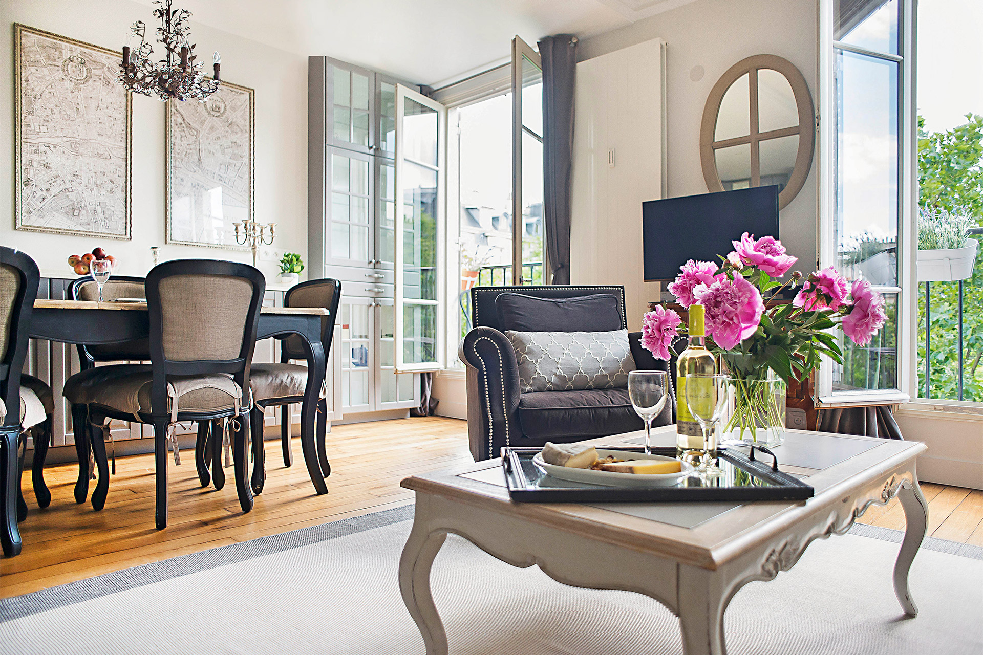 Open plan living room and dining area in the Bergerac vacation rental offered by Paris Perfect