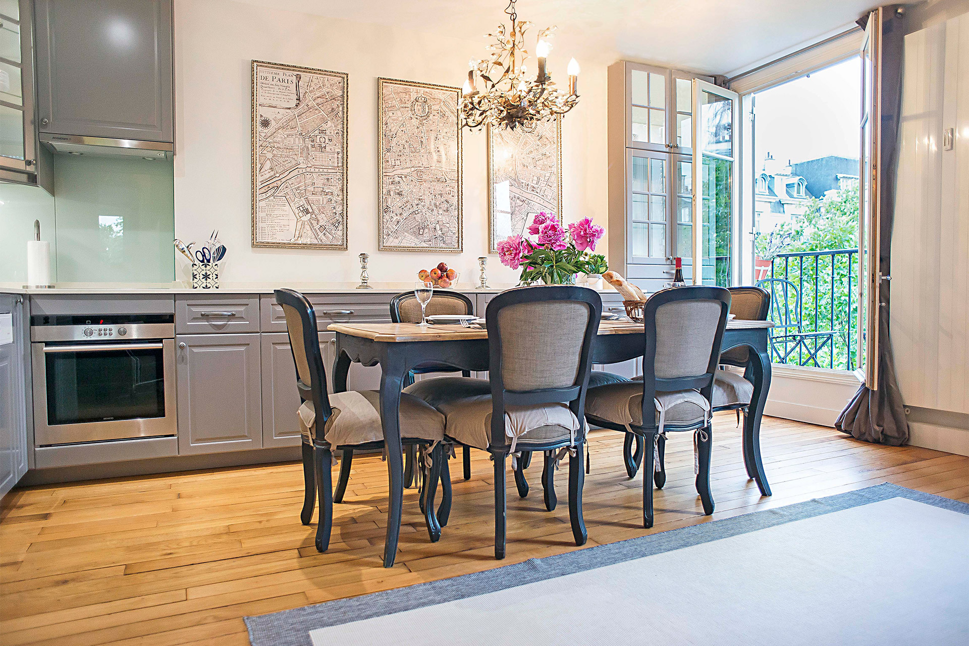 Dining table comfortably seats 6 people in the Bergerac vacation rental offered by Paris Perfect