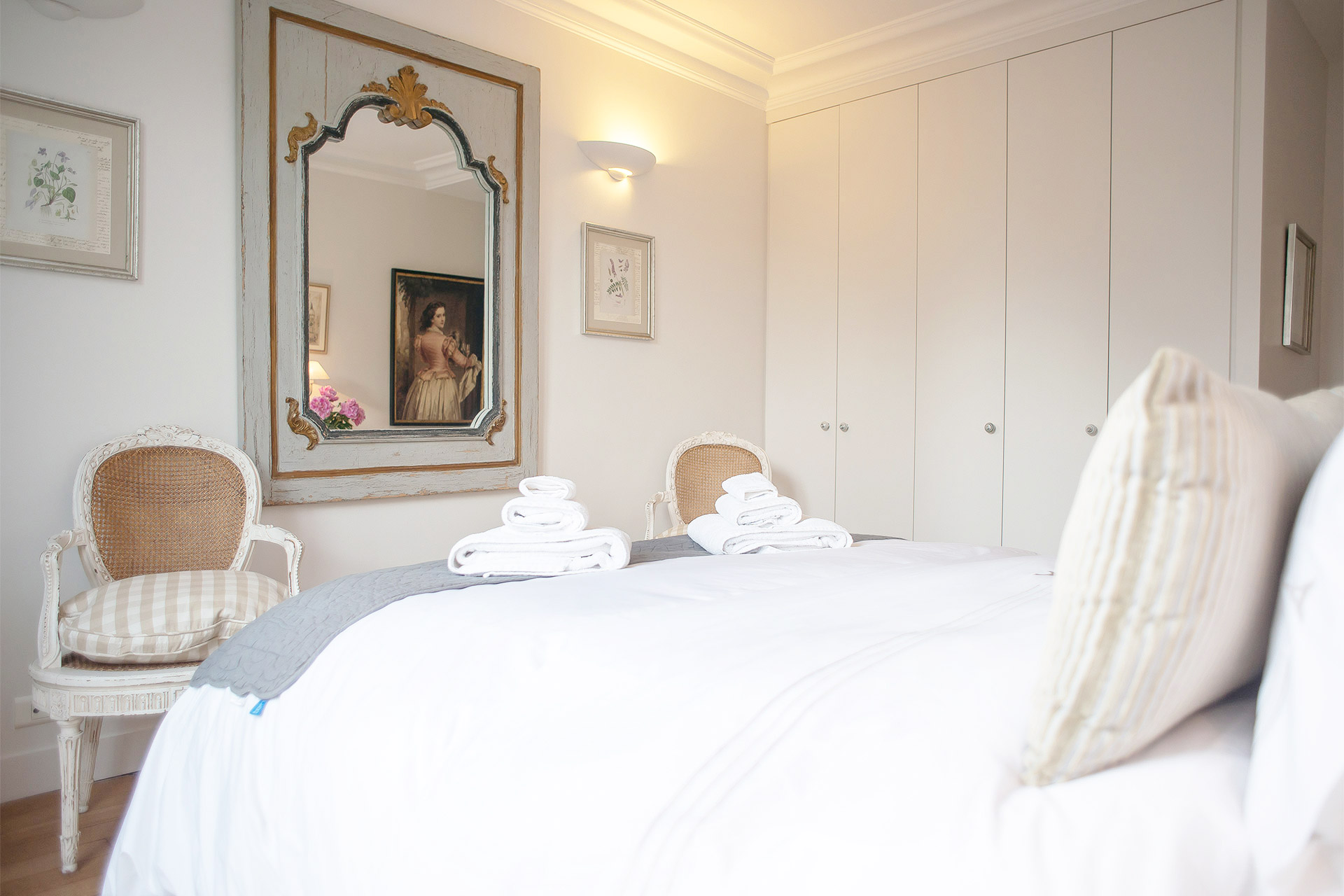 Stylish mirror at the foot of the bed in the Bergerac vacation rental offered by Paris Perfect