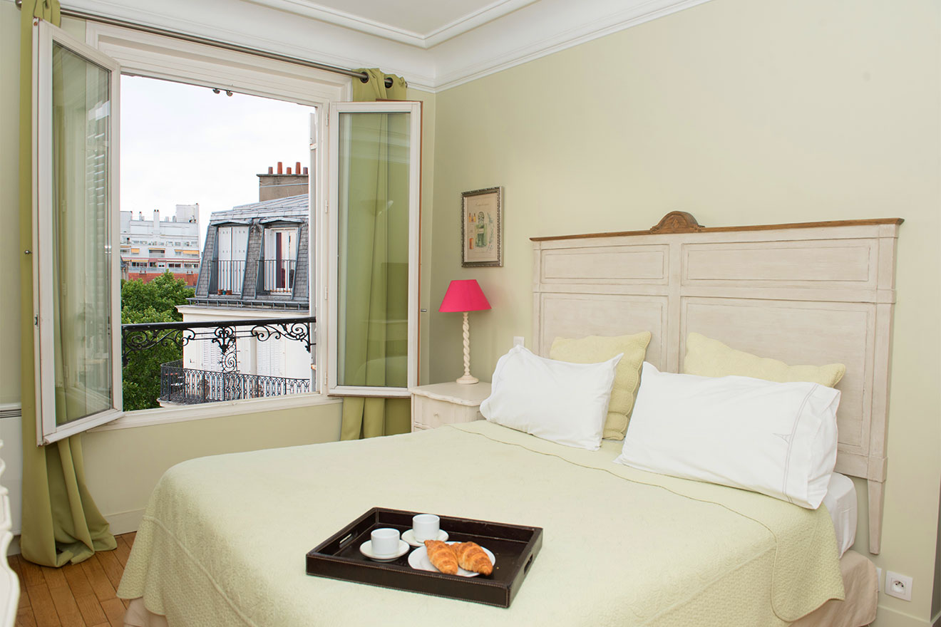 Enjoy breakfast in bed in the Bordeaux vacation rental offered by Paris Perfect