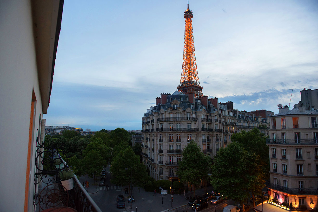 Eiffel Tower view at night from the balcony of the Bordeaux vacation rental offered by Paris Perfect