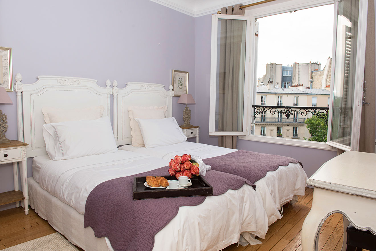 Bedroom 2 with Eiffel Tower views in the Bordeaux vacation rental by Paris Perfect