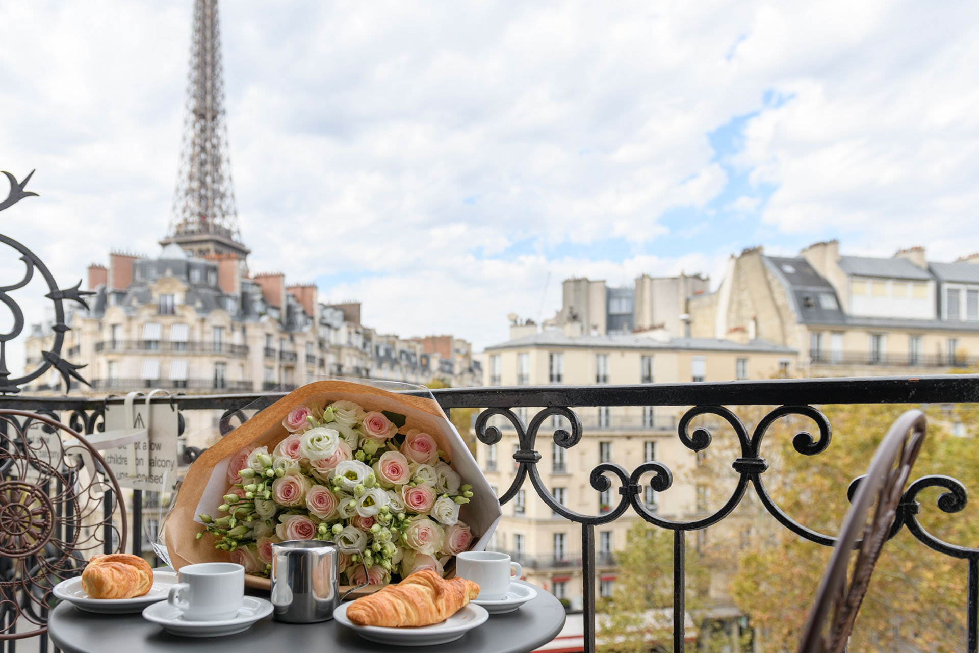 Dine al fresco on your balcony in the Bordeaux vacation rental offered by Paris Perfect