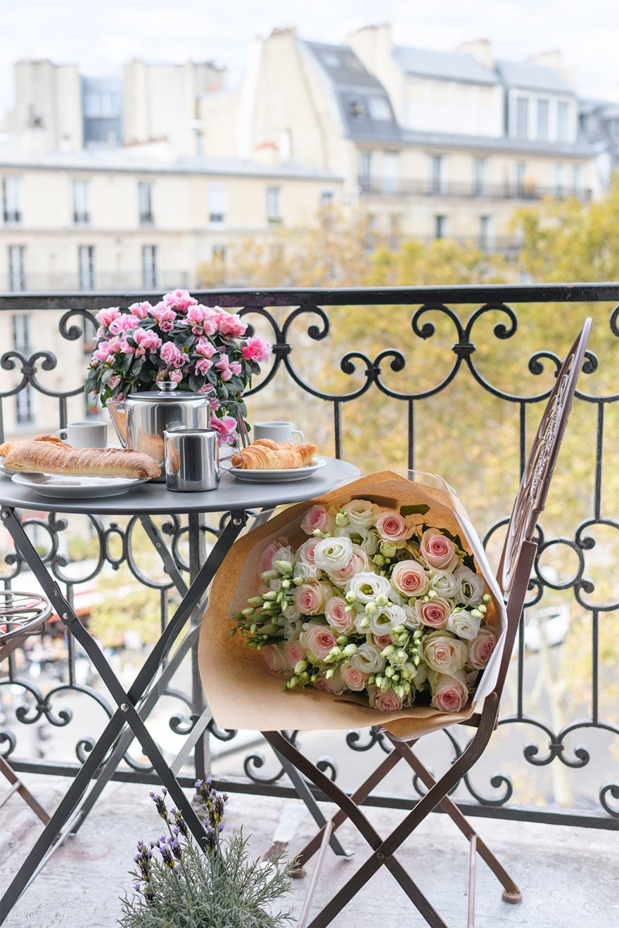 Balcony with a bistro table and chairs in the Bordeaux vacation rental by Paris Perfect