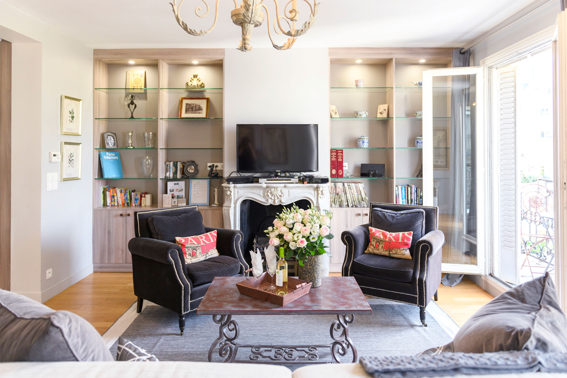 Charming Parisian fireplace in the Bordeaux vacation rental offered by Paris Perfect