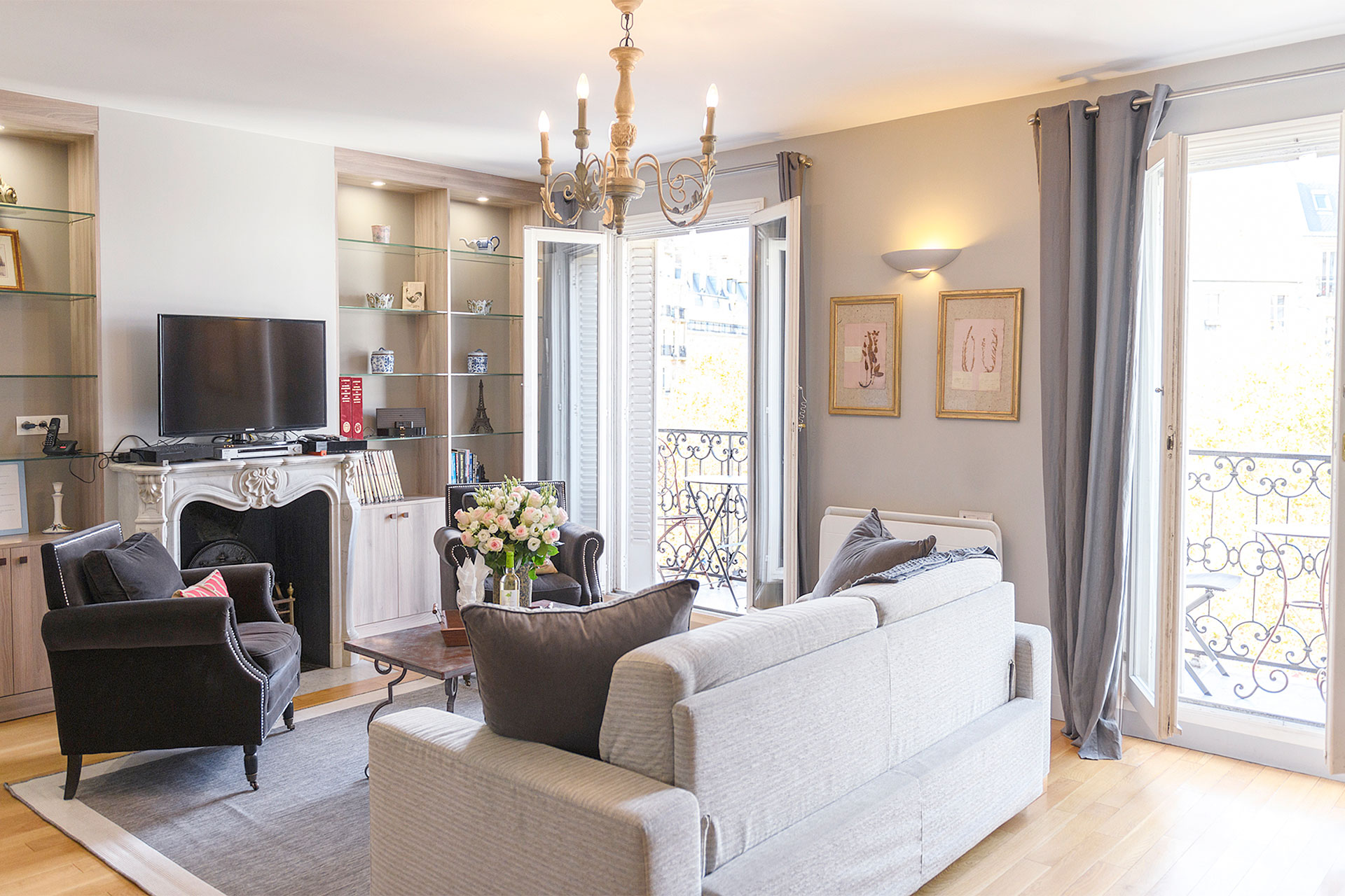 Large French windows in the living room of the Bordeaux vacation rental offered by Paris Perfect