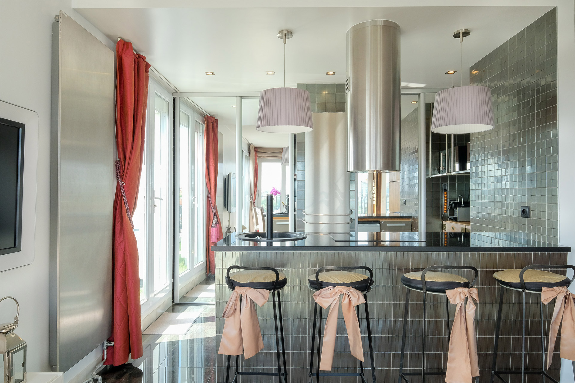 Bar stools along the kitchen island for casual dining at the Bordeneuve Paris Perfect rental