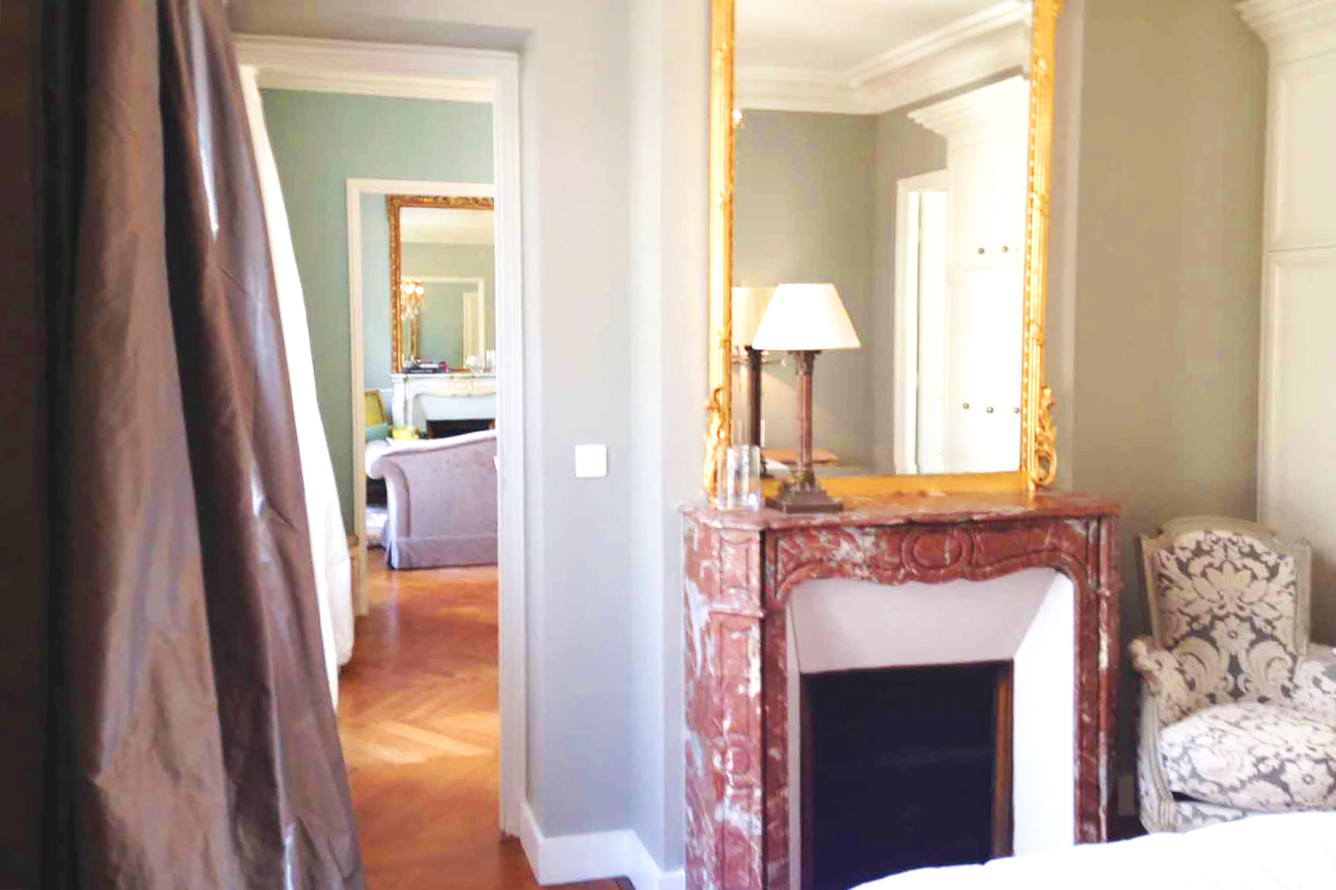 View from the first bedroom towards the dining and living rooms in the Bourgogne Paris Perfect rental
