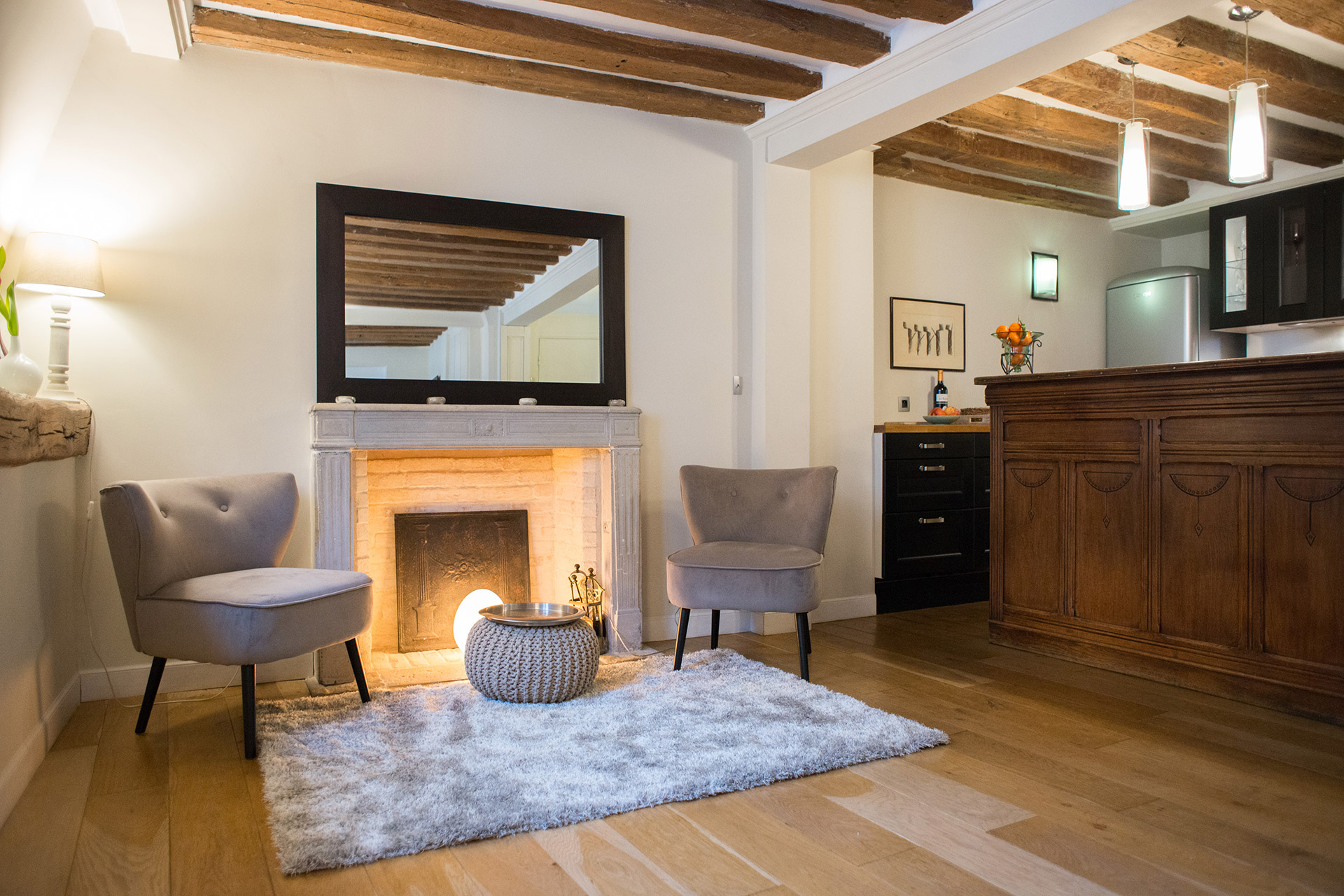 Cozy sitting room with beautiful exposed beam ceiling of the Brittany vacation rental offered by Paris Perfect