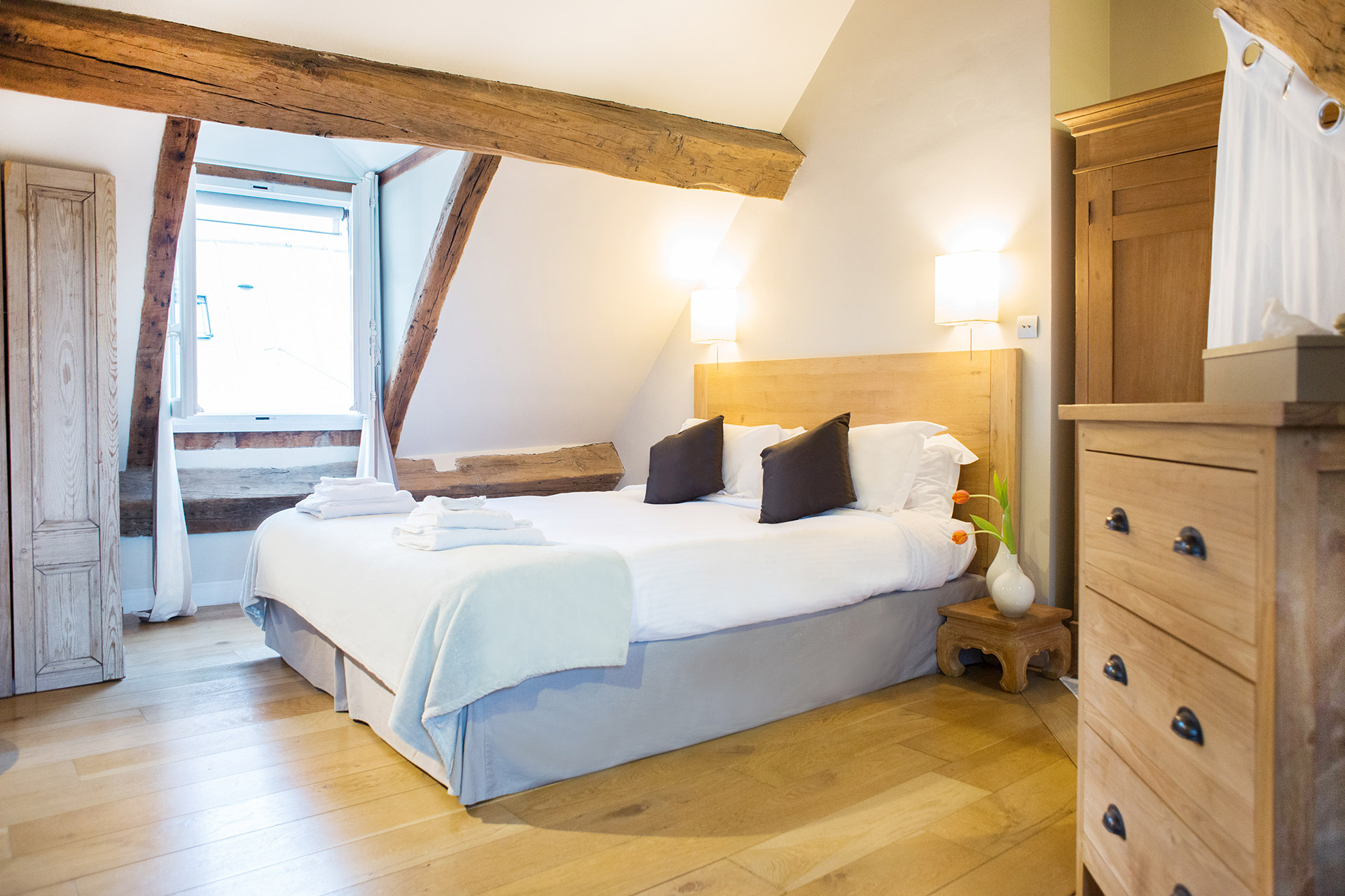 One of the bedrooms of the Brittany vacation rental offered by Paris Perfect