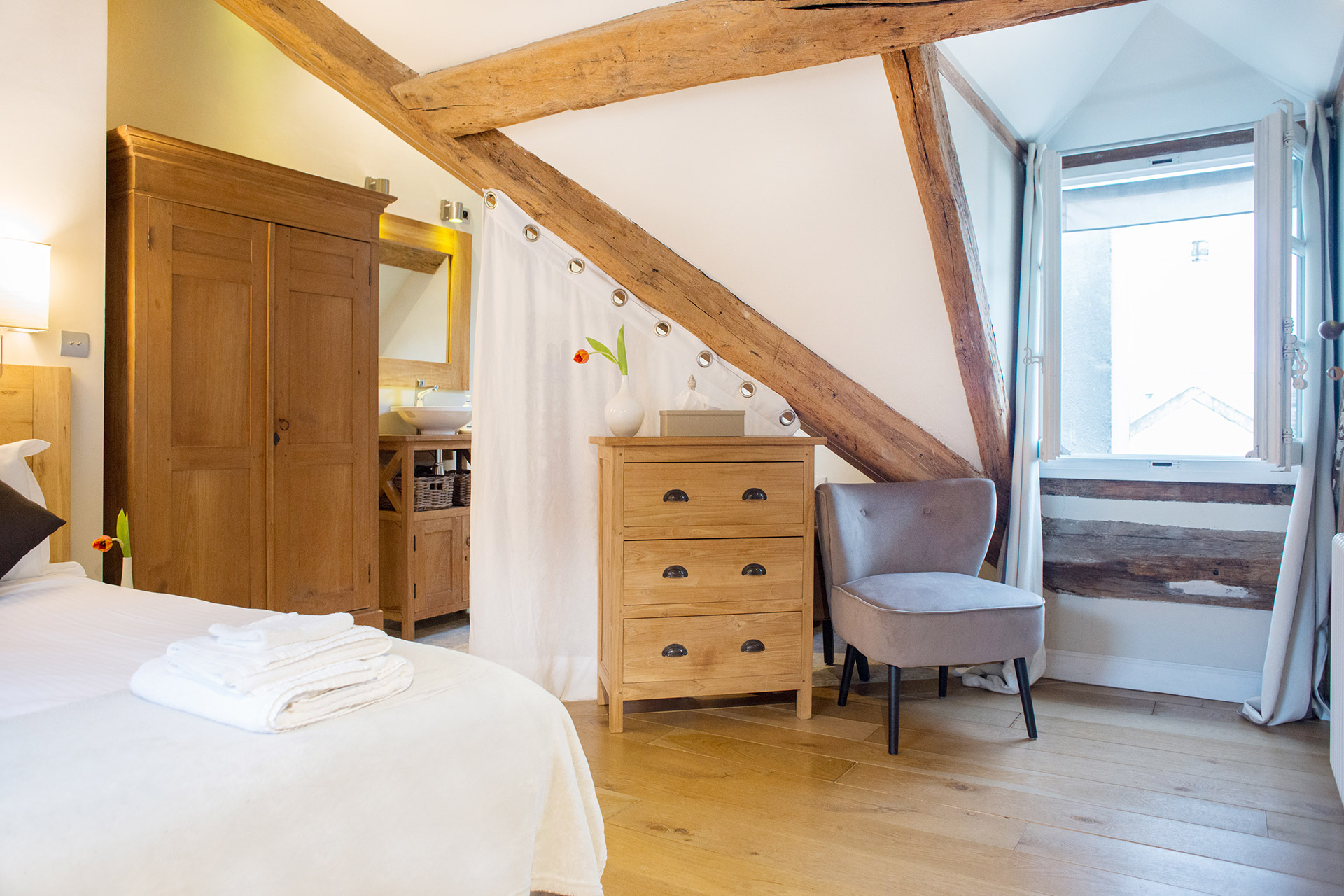 A spacious bedroom with beautiful Parisian views in the Brittany vacation rental offered by Paris Perfect