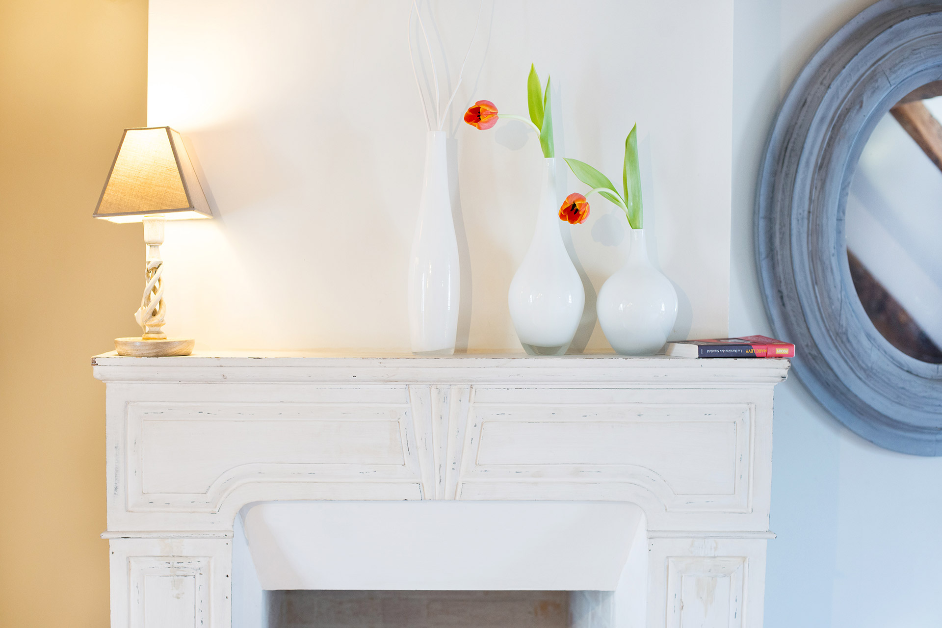 The delightful feature mantelpiece of the Brittany vacation rental offered by Paris Perfect