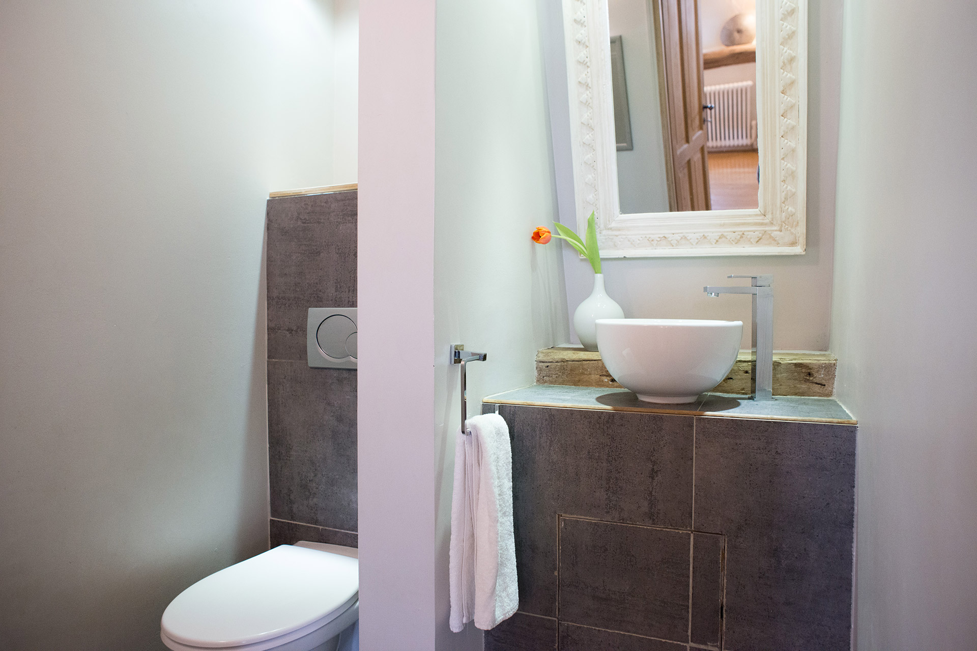 The half bath on the first level of the Brittany vacation rental offered by Paris Perfect