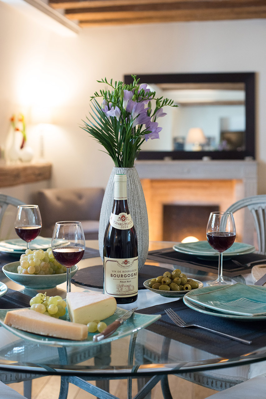 Enjoy eating at home at the full dining table of the Brittany vacation rental offered by Paris Perfect