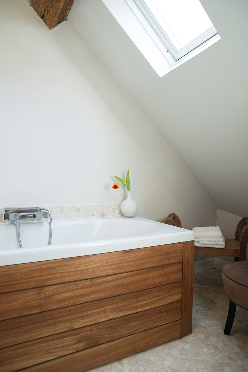 The en suite is equipped with a luxurious bathtub in the Brittany vacation rental offered by Paris Perfect
