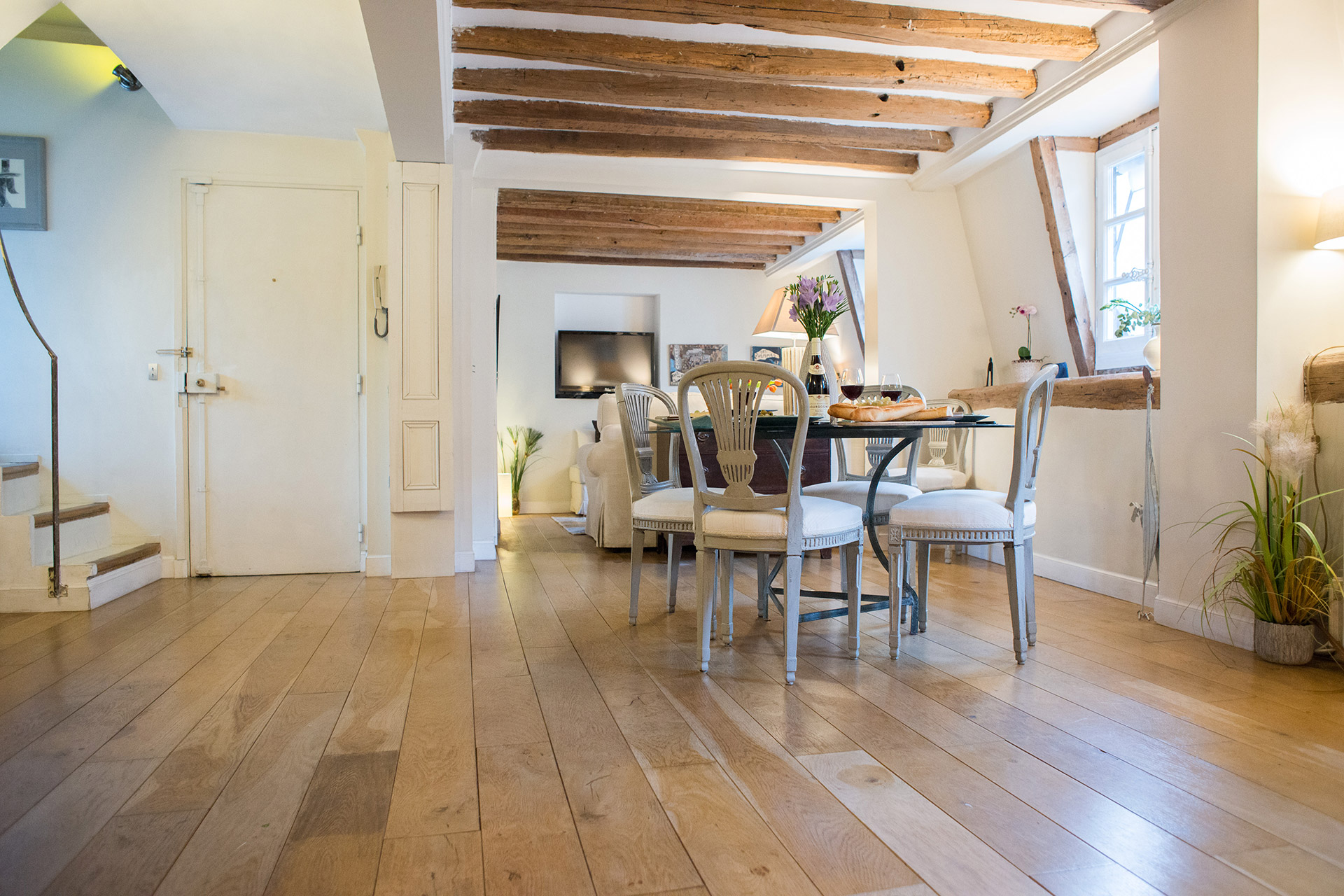 The spacious open-plan living and dining area of the Brittany vacation rental offered by Paris Perfect
