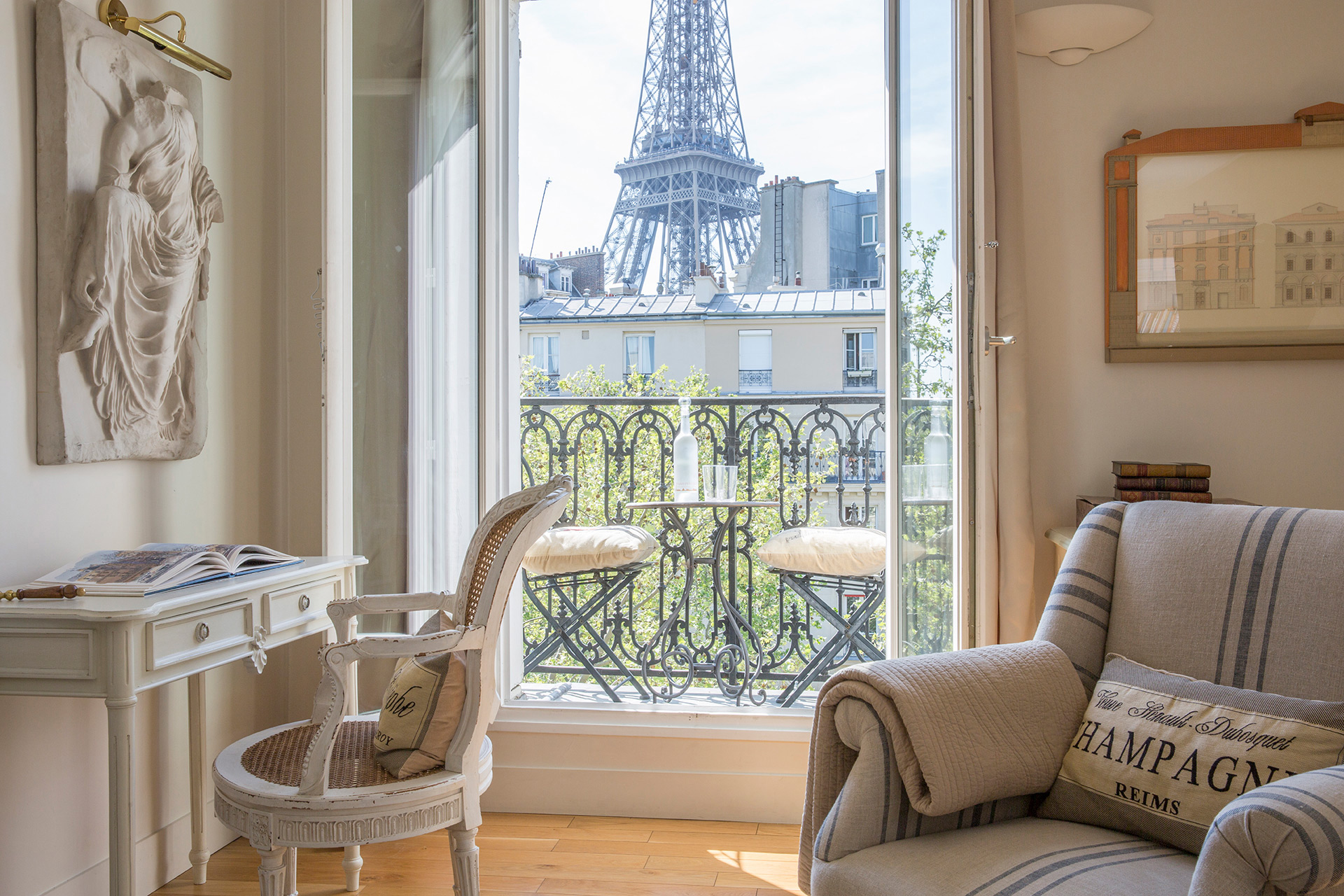 Eiffel Tower views from the living room of the Cabernet vacation rental offered by Paris Perfect