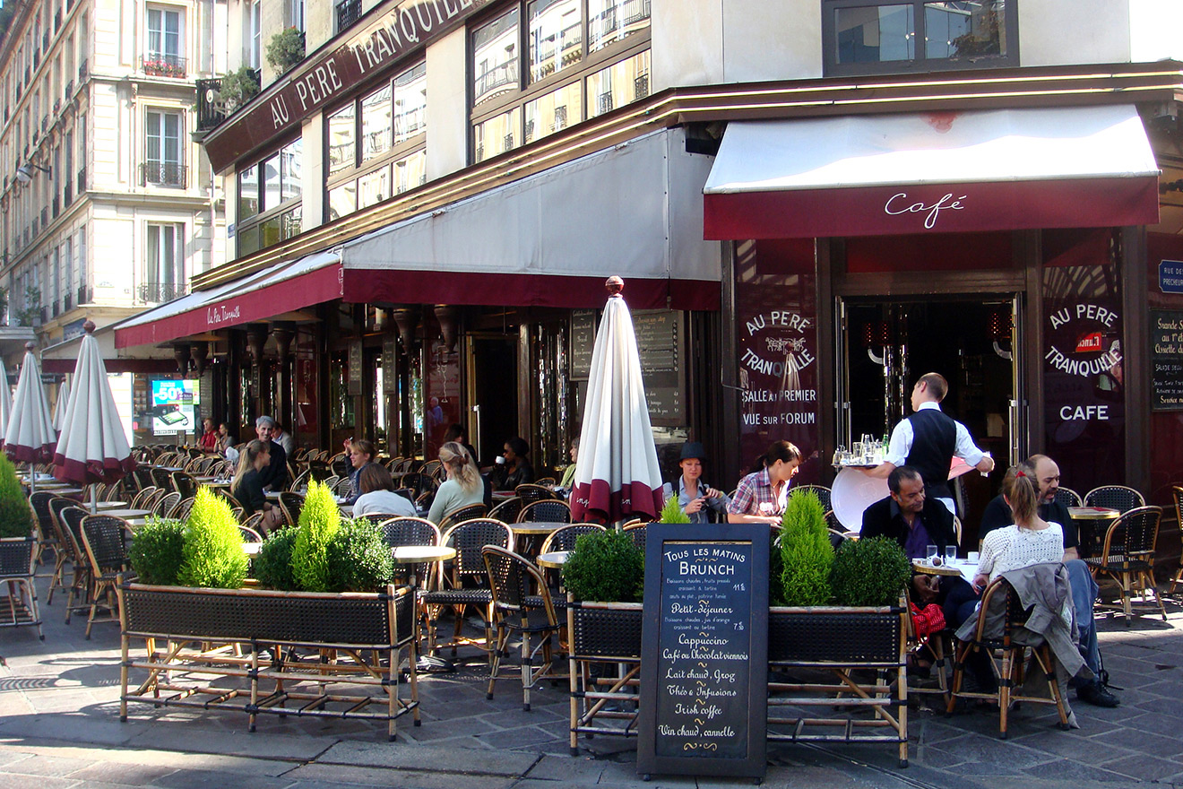 Sit back and watch daily life pass by in a Parisian café