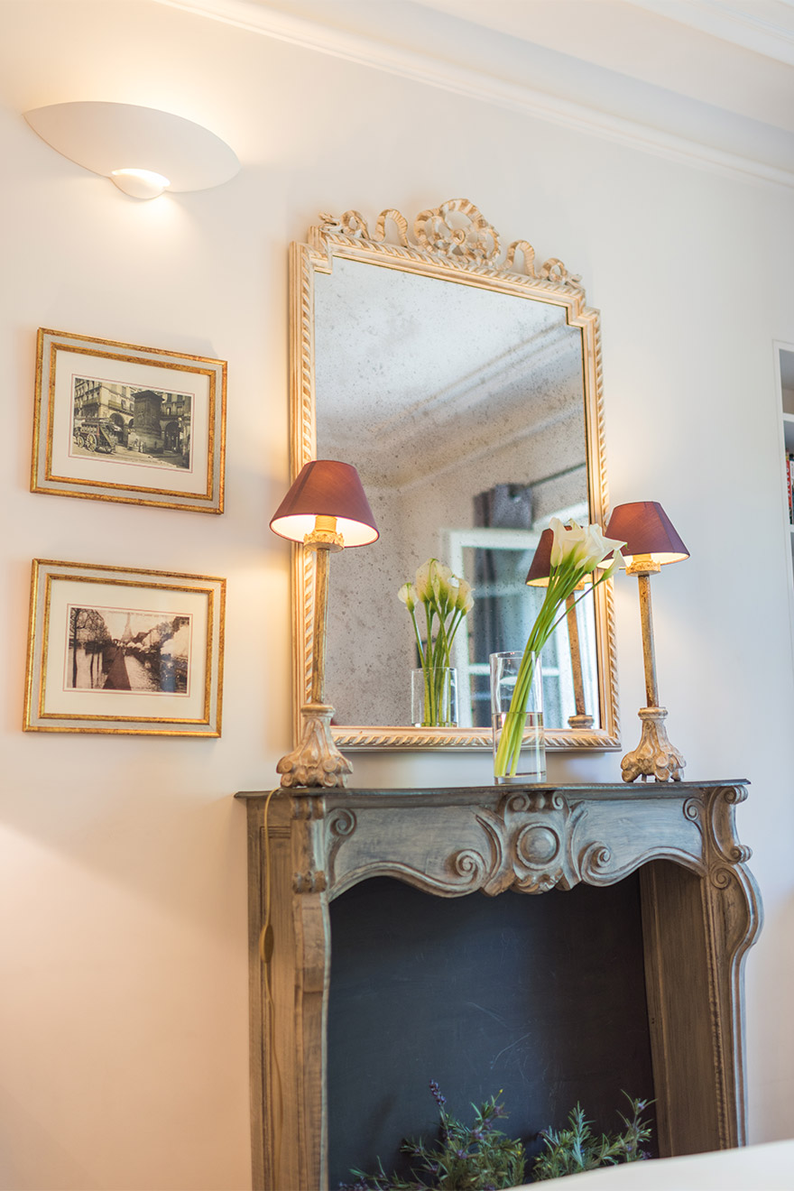 Elegant decorative fireplace in the Calvados vacation rental offered by Paris Perfect