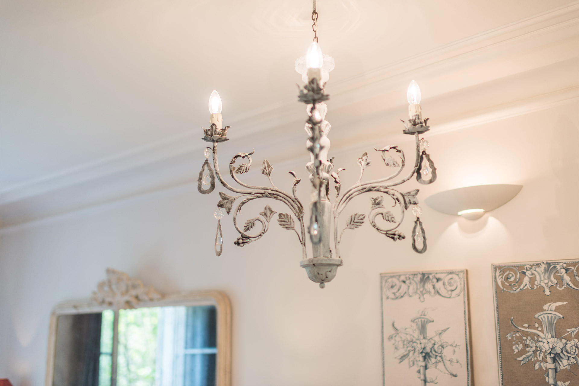 Bright and elegant chandelier in the Calvados vacation rental offered by Paris Perfect