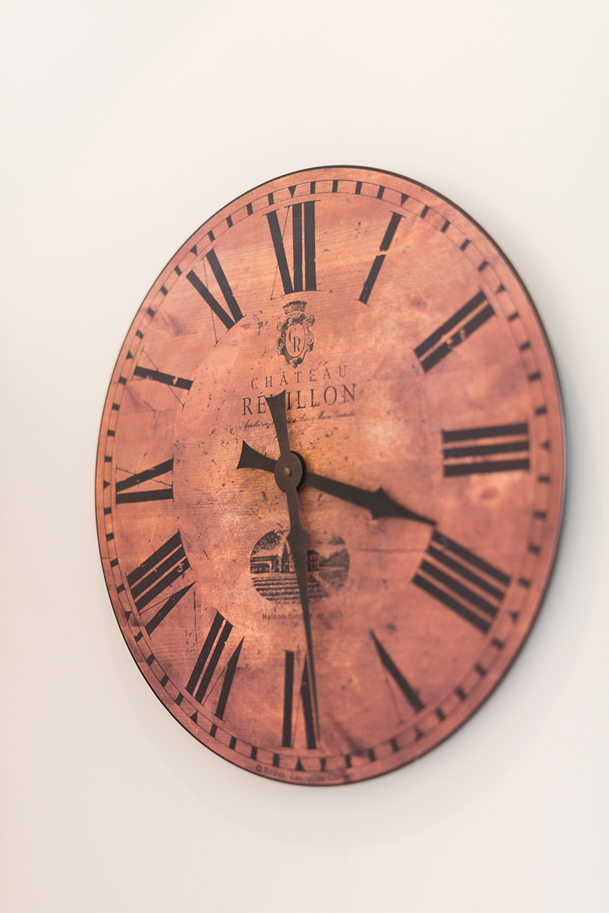 Antique clock in the kitchen of the Calvados vacation rental offered by Paris Perfect