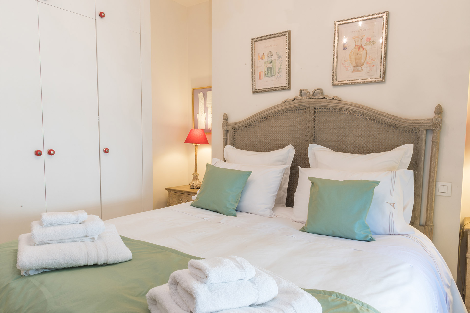 Built-in closets in the bedroom of the Calvados vacation rental offered by Paris Perfect