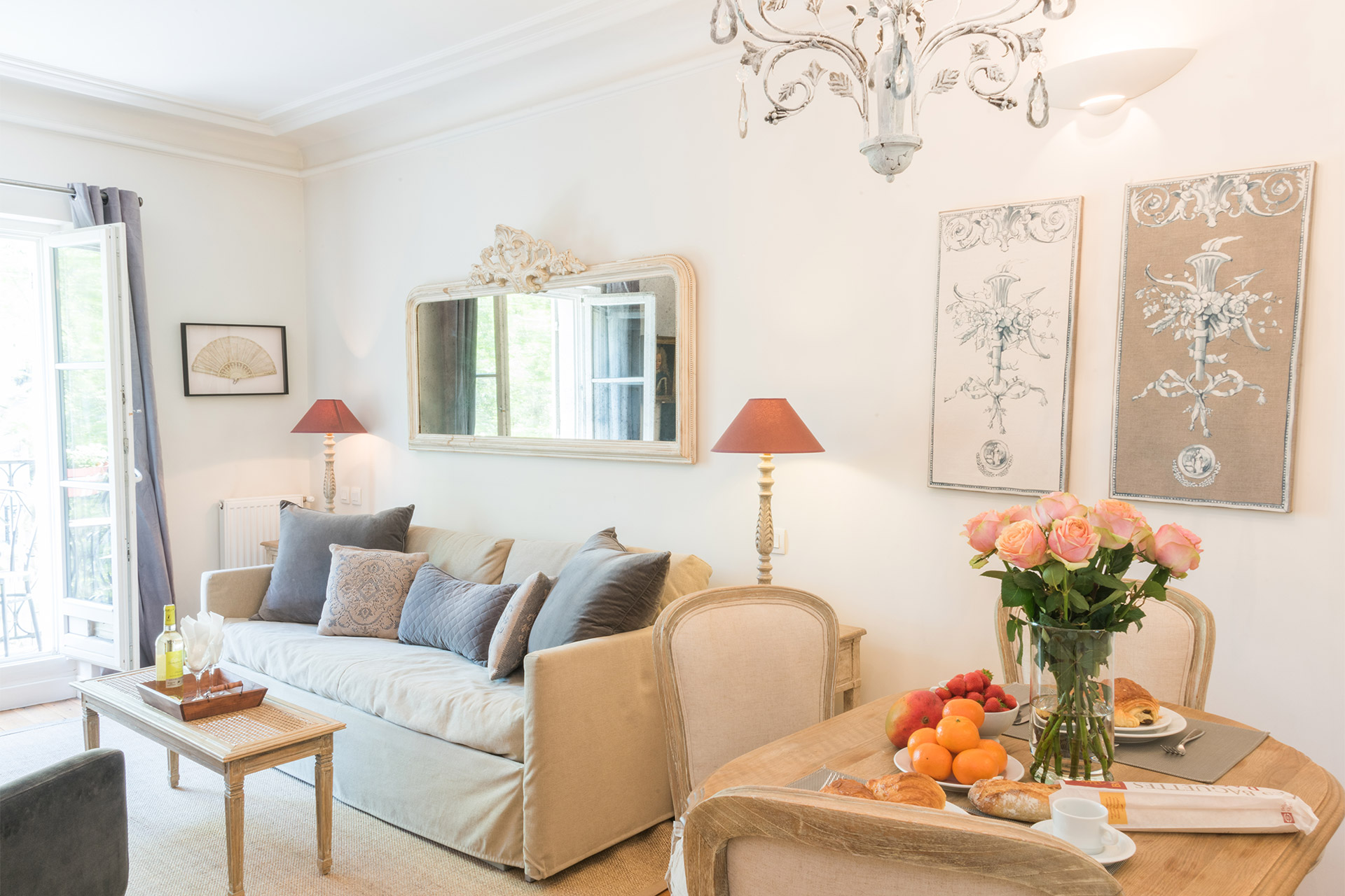 Bright and airy living room of the Calvados vacation rental offered by Paris Perfect
