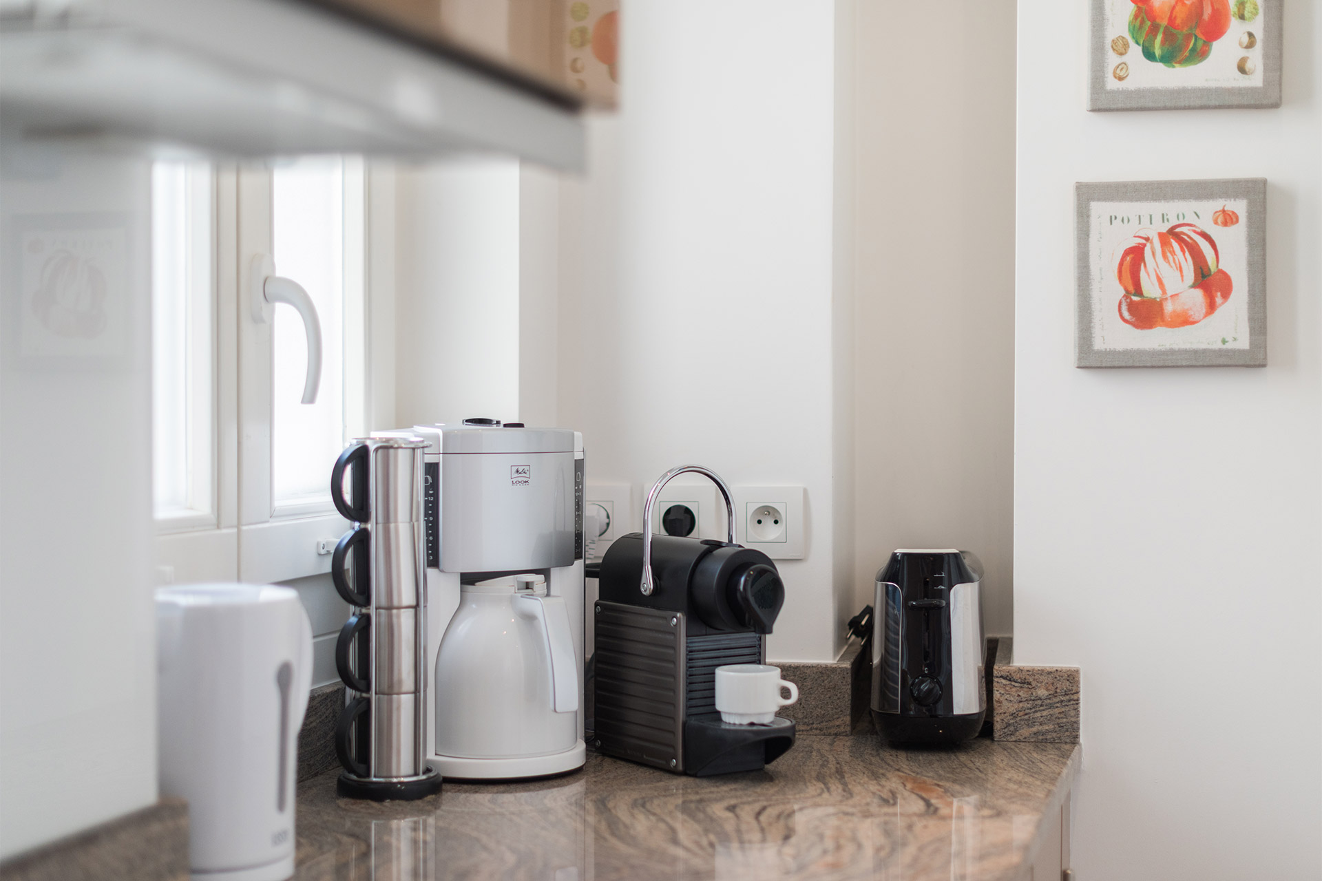 Nespresso and coffee machine in the kitchen of the Calvados vacation rental offered by Paris Perfect