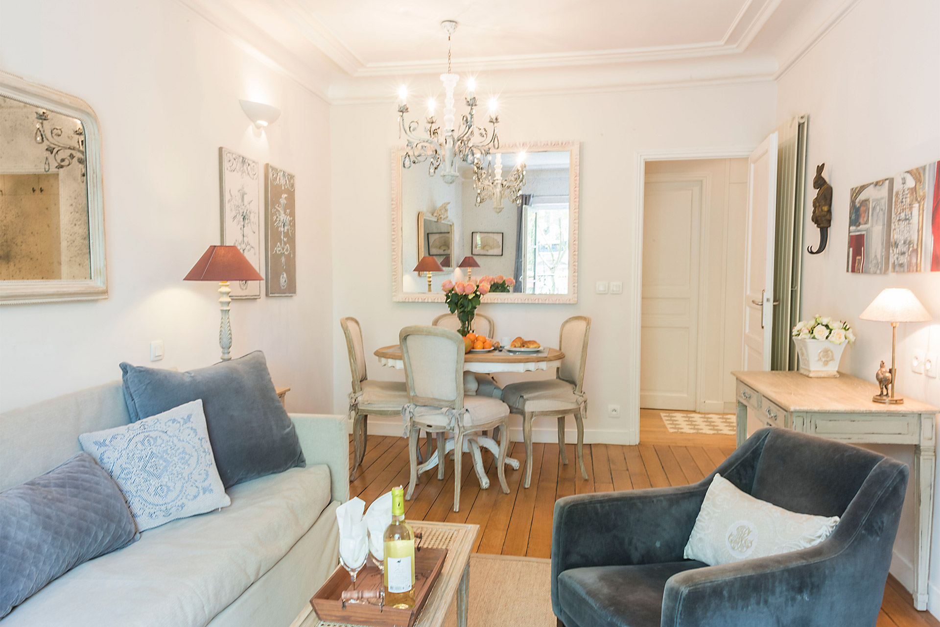Open living and dining area of the calvados vacation rental offered by paris perfect