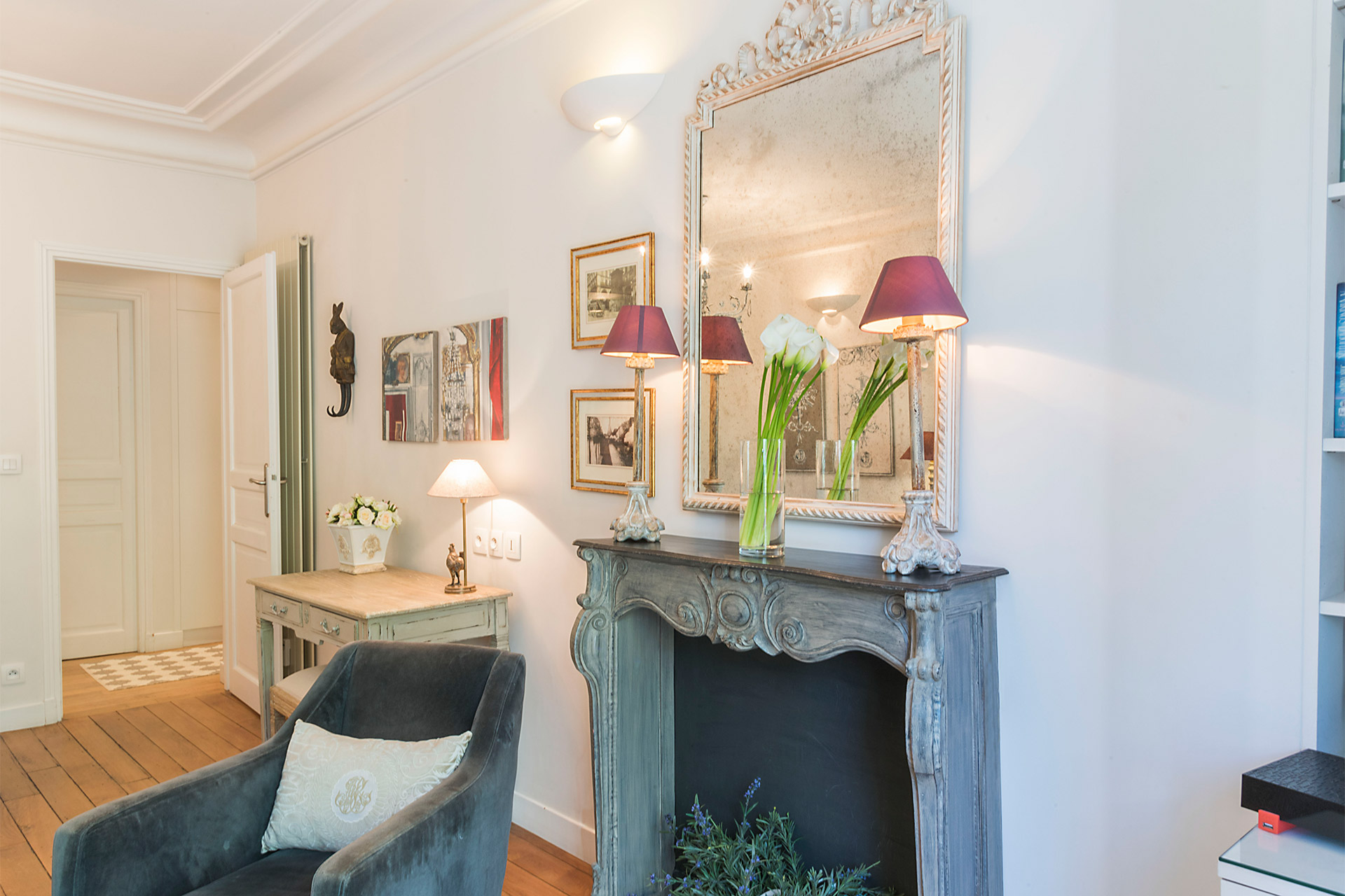 Elegant seating area features a decorative fireplace in the Calvados vacation rental offered by Paris Perfect