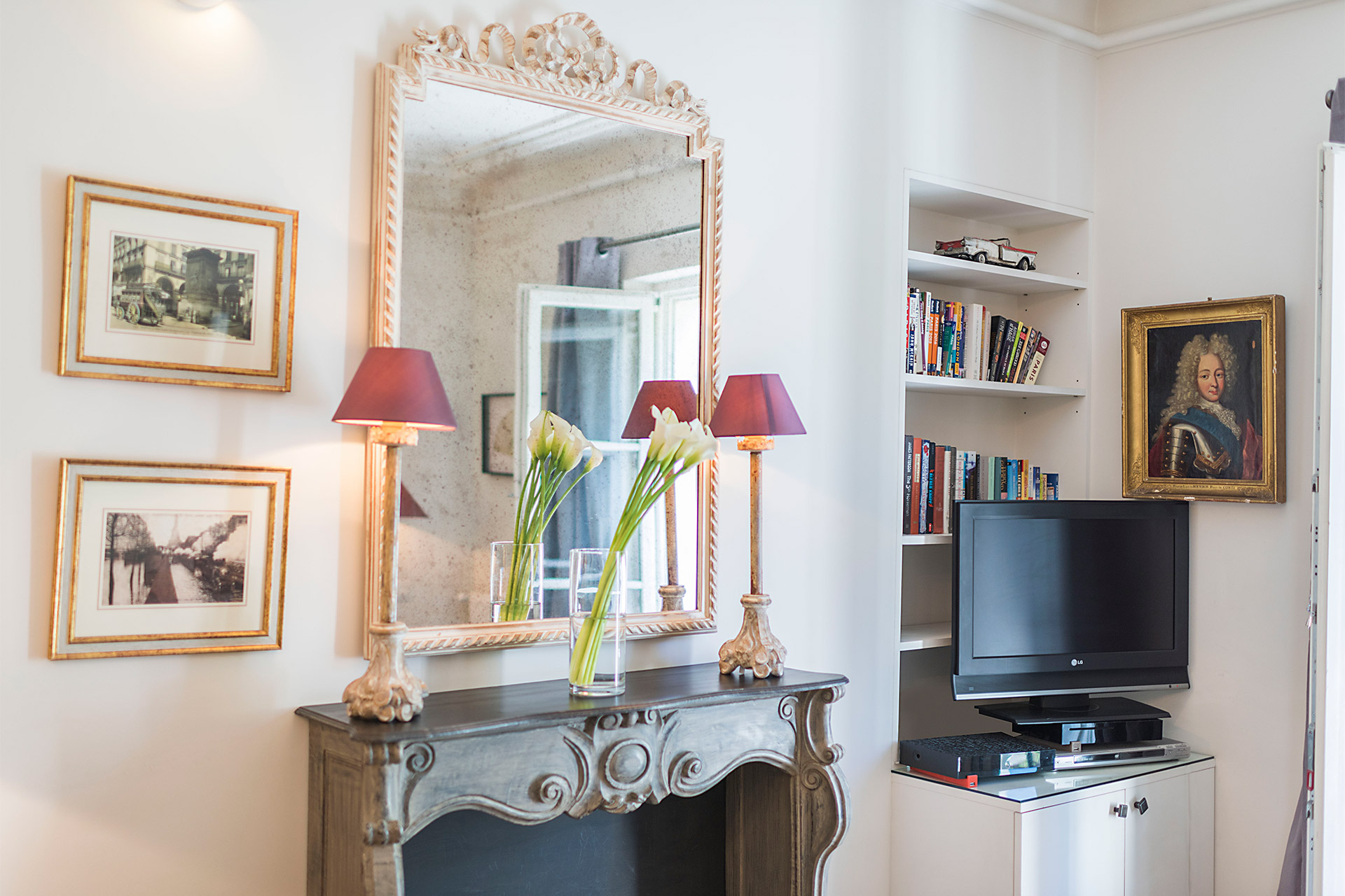 Sofa facing the fireplace and TV in the Calvados vacation rental offered by Paris Perfect