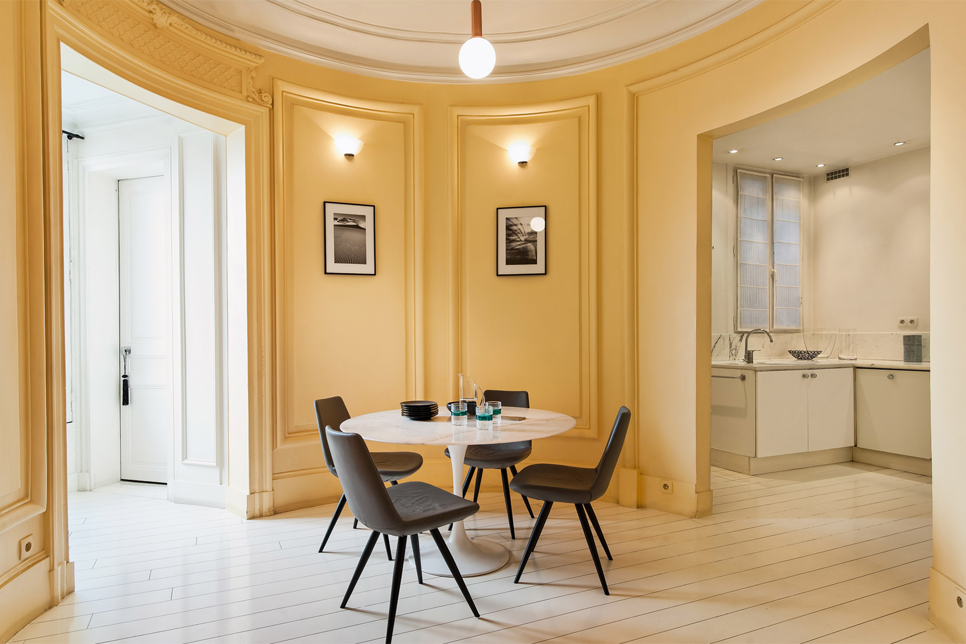 Unique round breakfast nook next to the kitchen in the Cavailles Paris rental