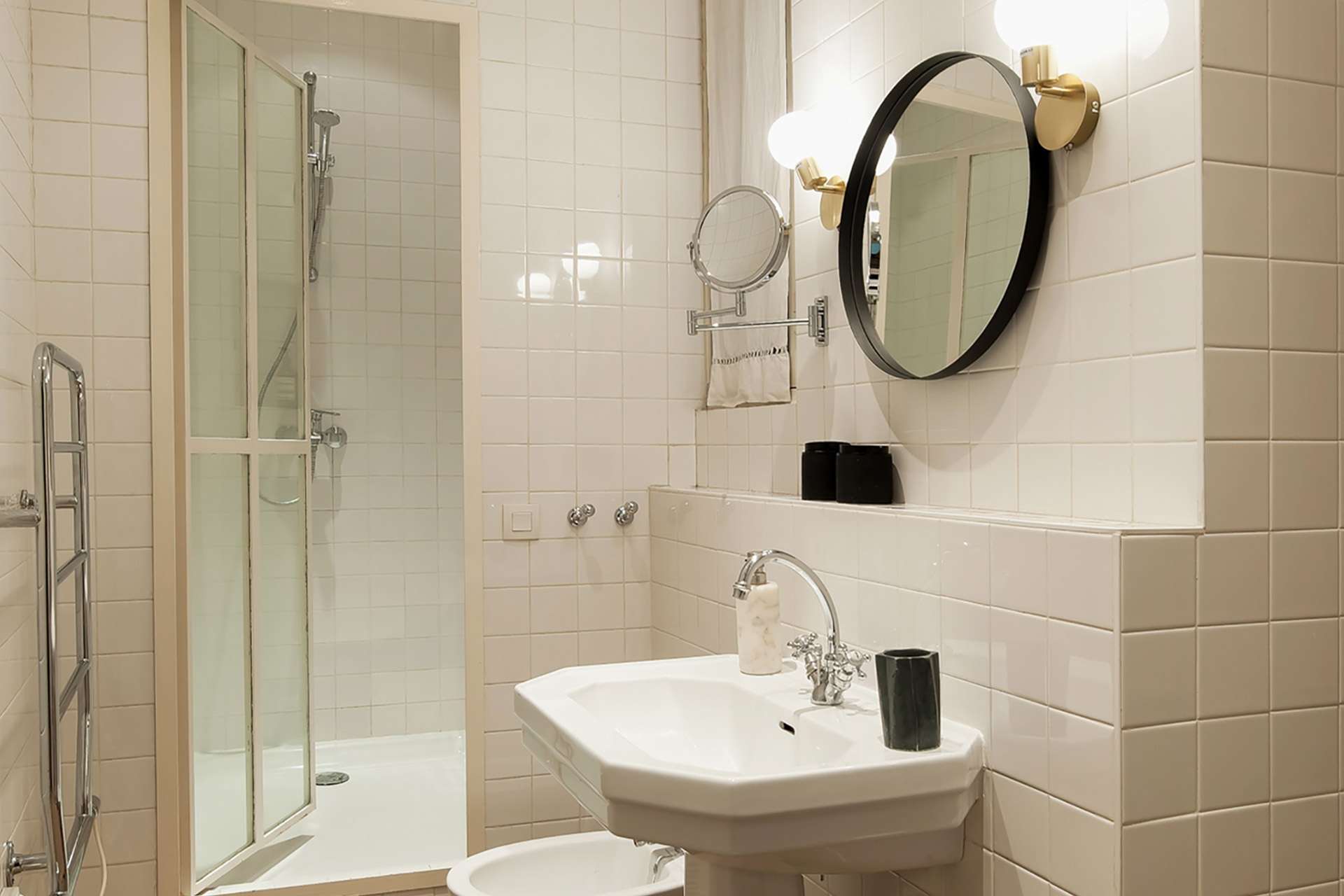 Bathroom one featuring a bathtub, shower, sink, toilet and bidet in the Cavailles Paris rental