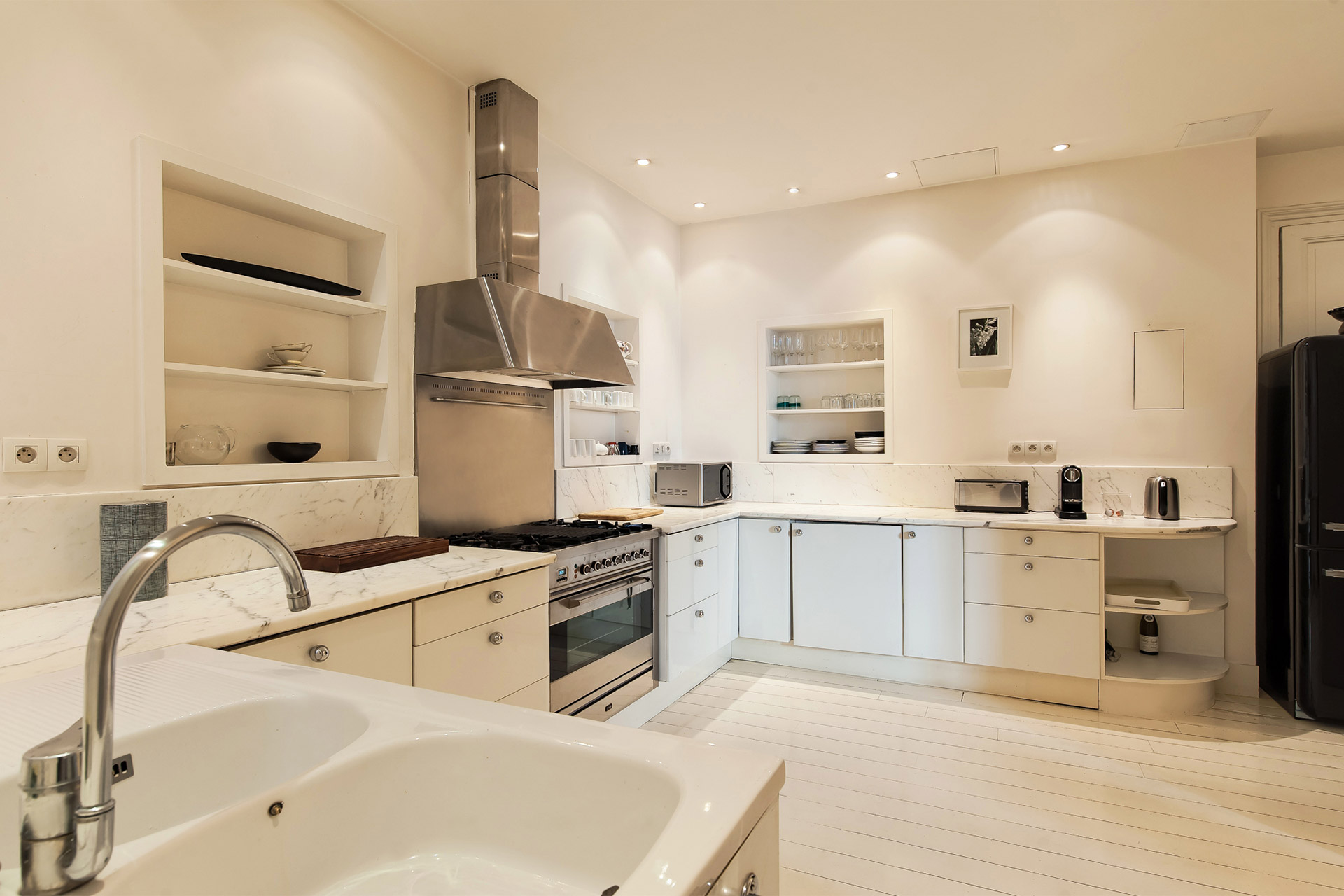 Large kitchen in the Cavailles Paris rental with modern appliances plus everything you need to cook at home