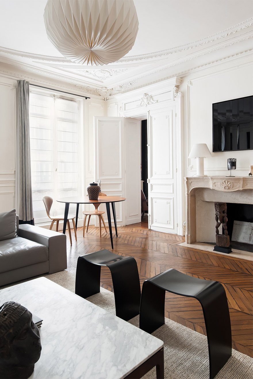 Chic modern decor perfectly counterbalancing this classic French apartment