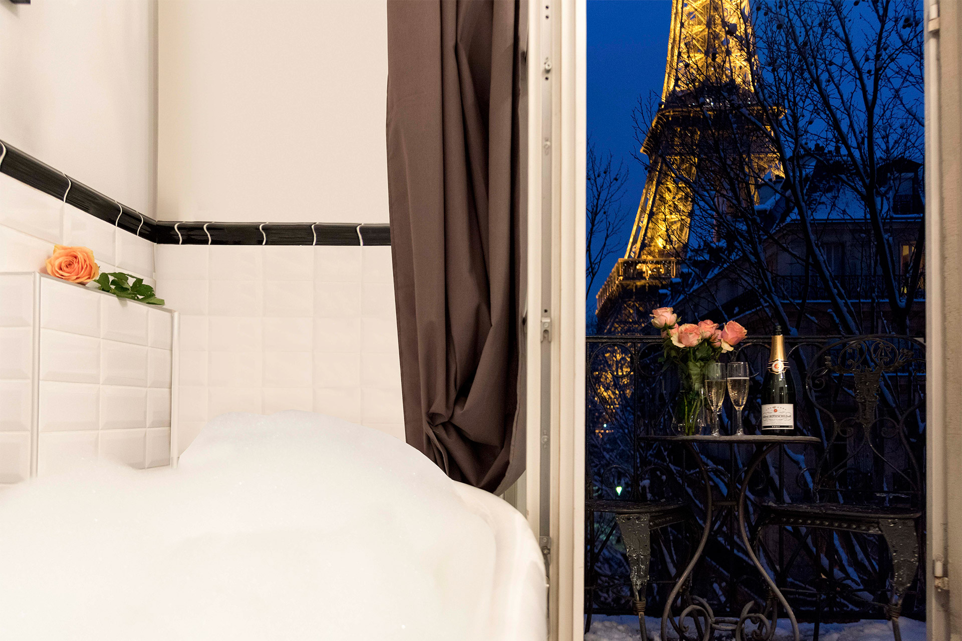 Romantic bathroom with Eiffel Tower view in the Chambertin vacation rental offered by Paris Perfect