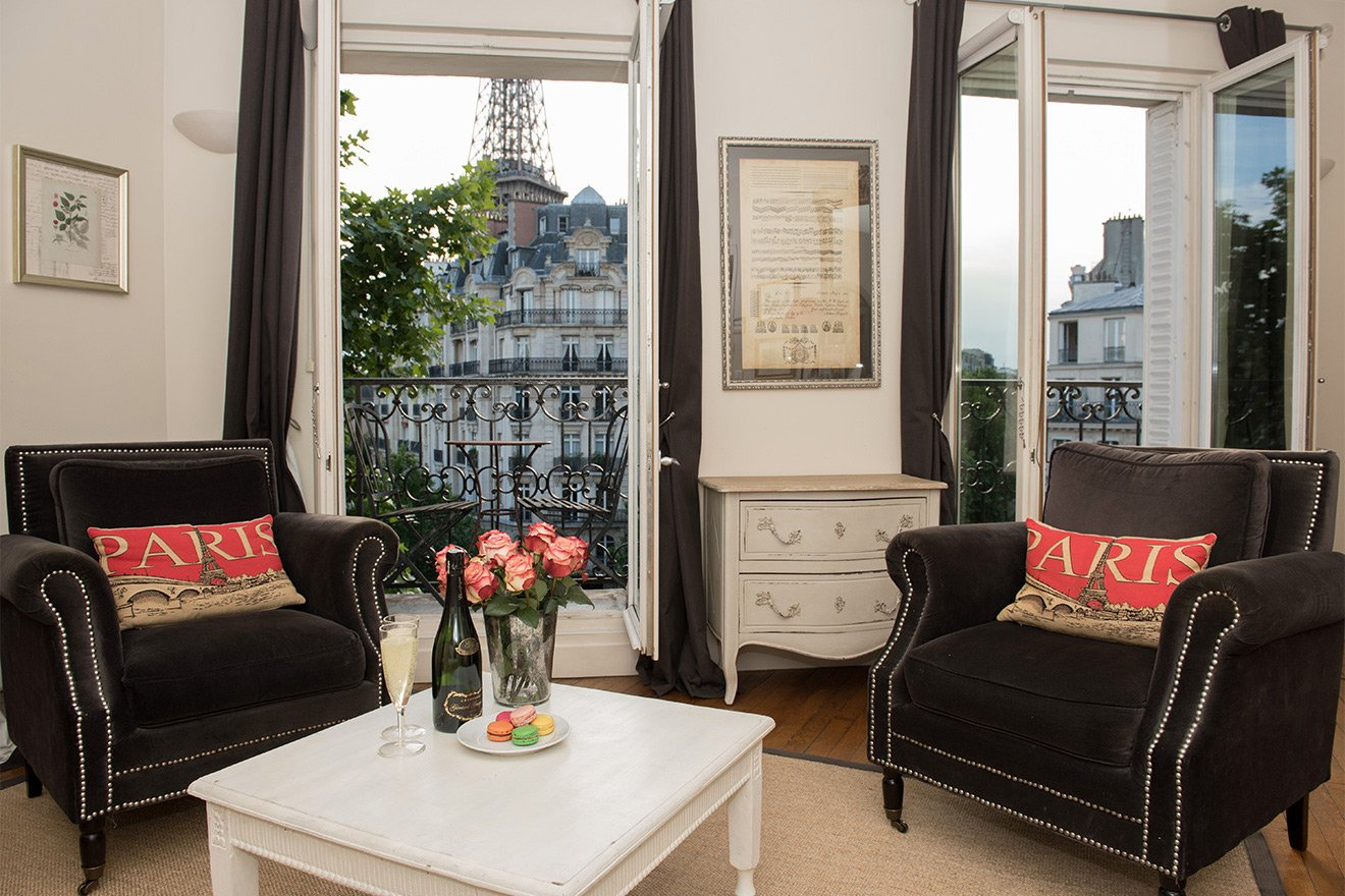 Champagne and delicious macaroons in the Champagne vacation rental offered by Paris Perfect